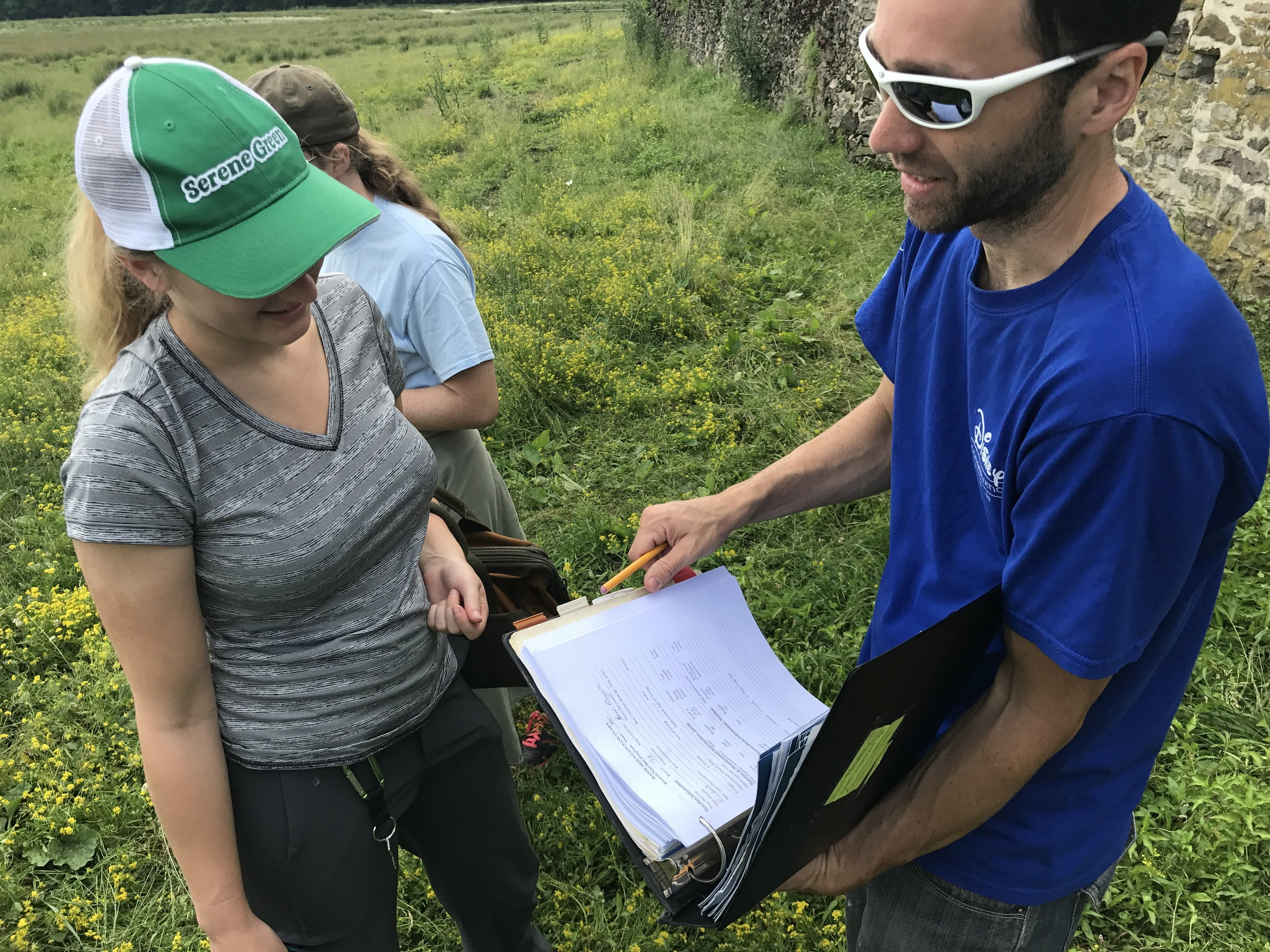 JF reviews American kestrel nest box data with summer intern Jenna Schlener. Photo by Gigi Romano.