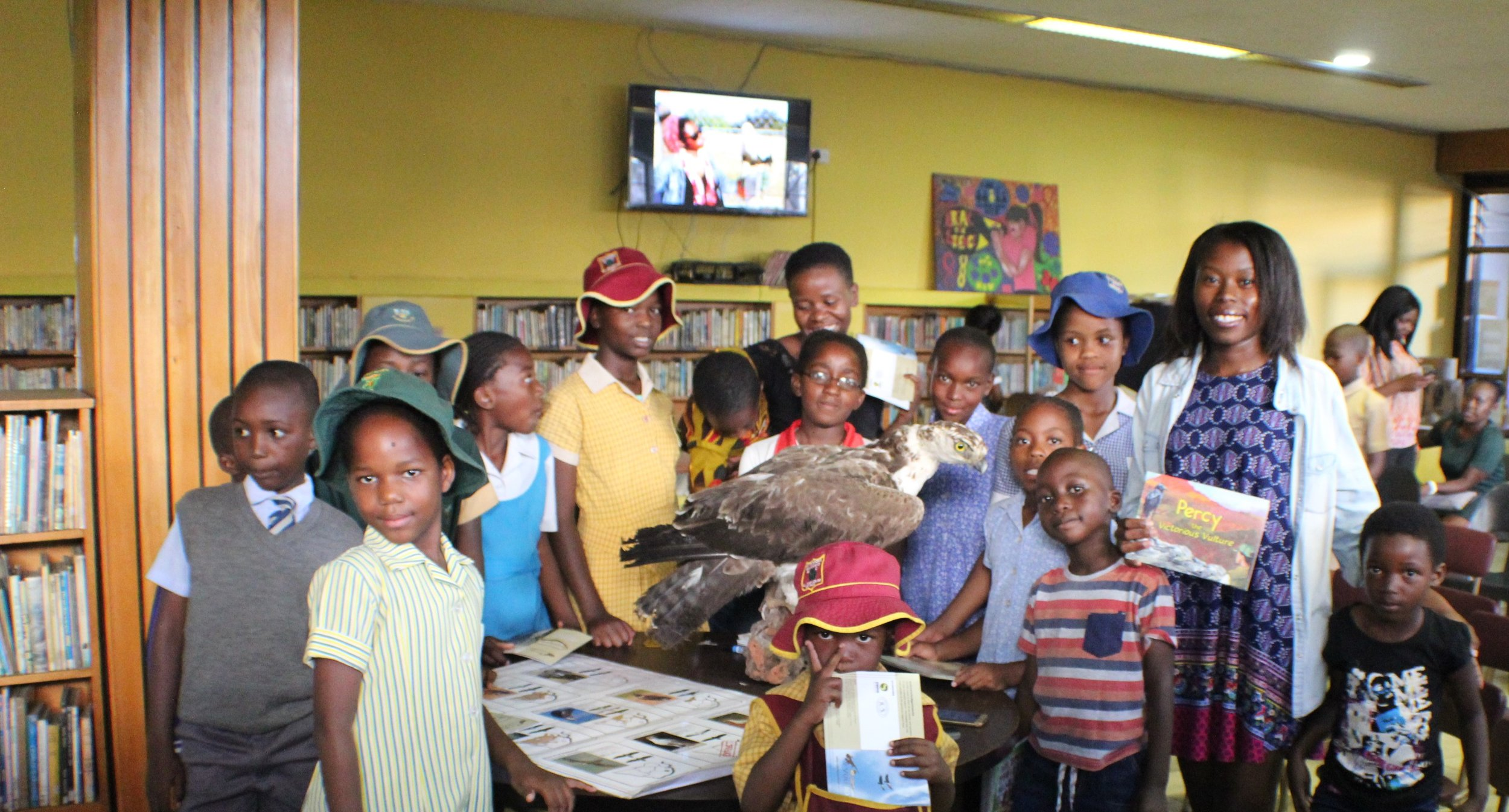 Merlyn (right) poses with some of the children who attended the education program.