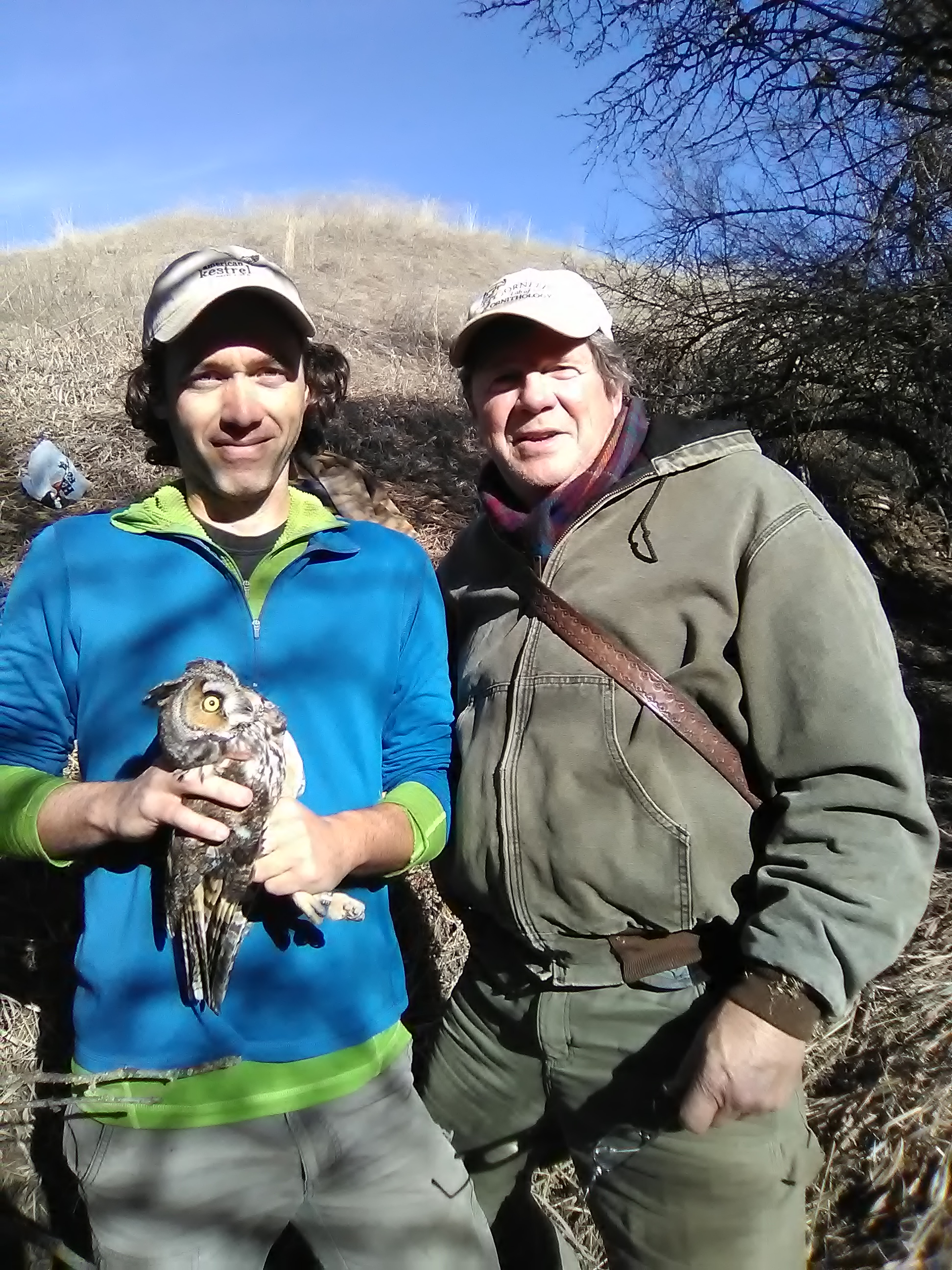 Dr. JF Therrien (senior research biologist at Hawk Mountain) and Denver Holt (founder and president of the Owl Research Institute) just before releasing a long-eared owl.
