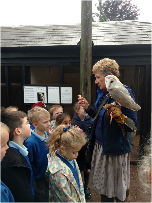Jemima Parry-Jones and a barn owl welcom school children to ICBP.