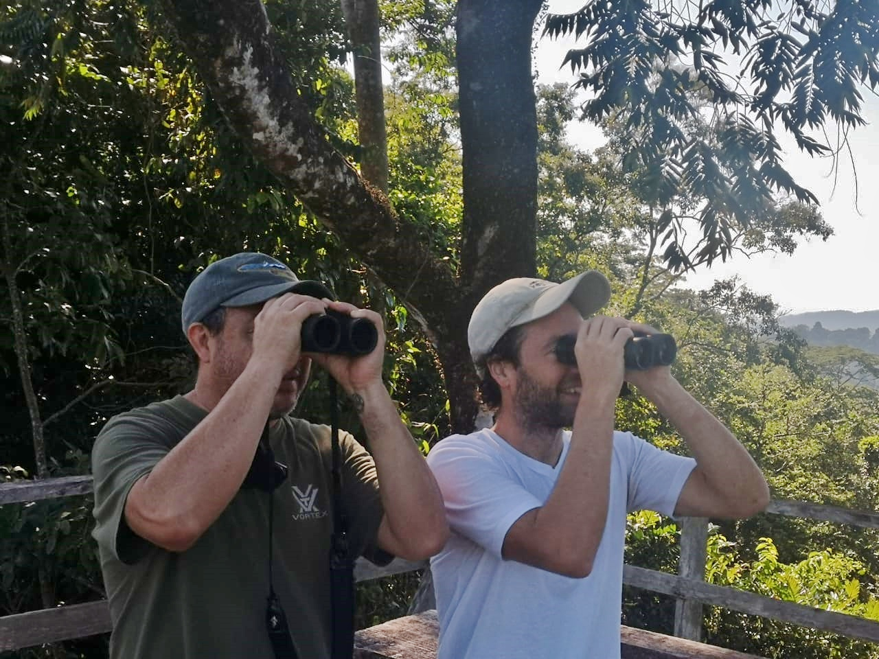 JF and Pablo searching with binoculars from the tower.