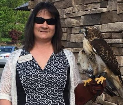 "Cheryl and the ""junior"" red-tailed hawk at the 2018 Benefit for the Birds gala."