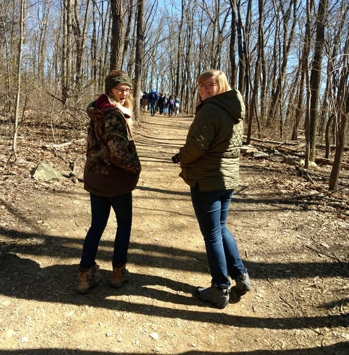 Riley (right) and the other spring education trainee Shannon (left) hiking up the Lookout Trail.