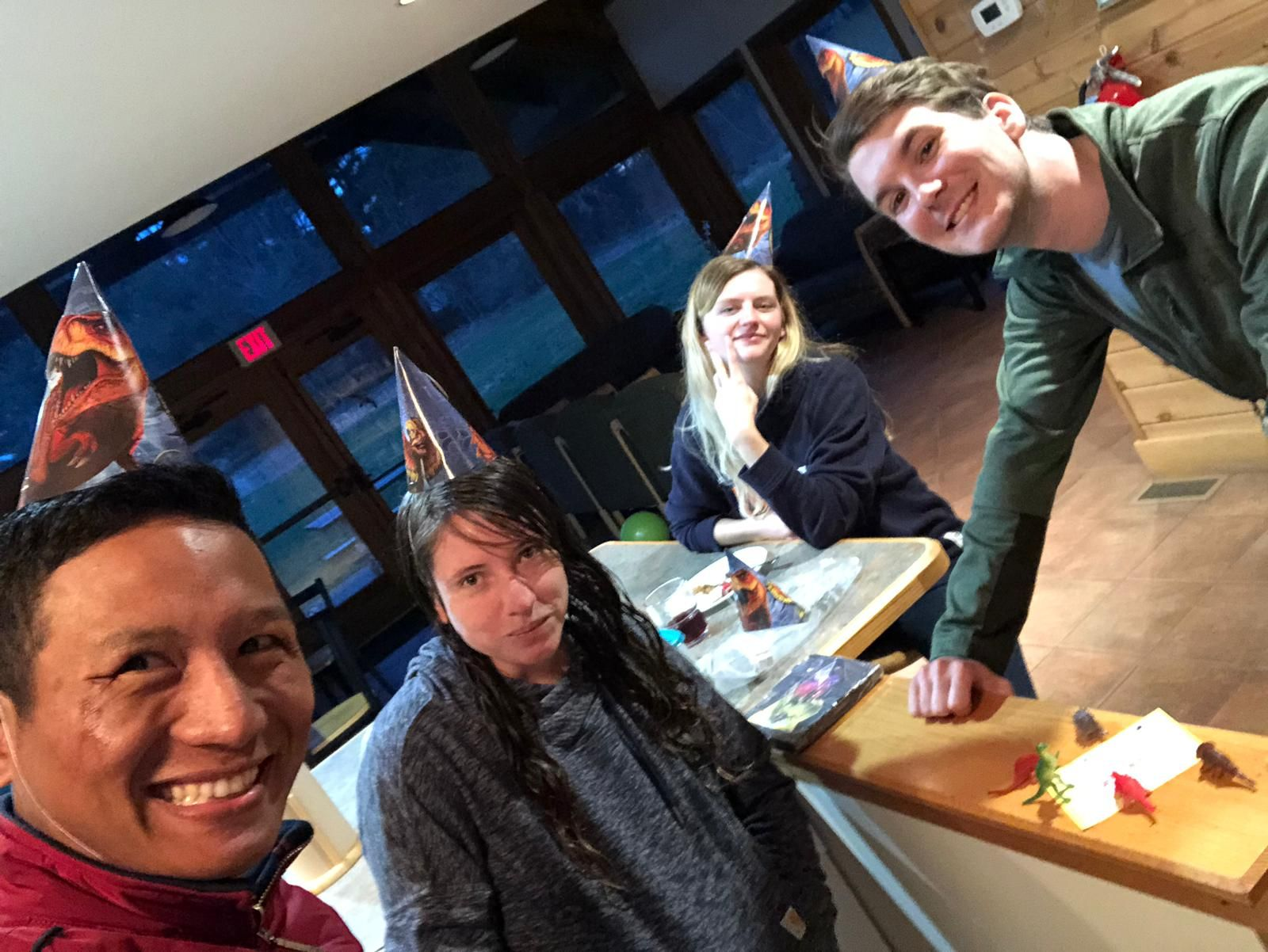 Lanso, Sandra, Shannon, and Colin celebrating a birthday in the Trainee Residence.