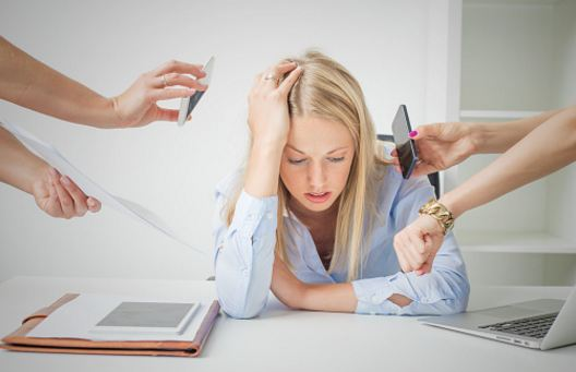This woman is very stressed from work and life in general, but Lindsey Vertner can help!  Life & Relationship Coach. Located in Bloomington, Indiana but working with clients nationally and worldwide!