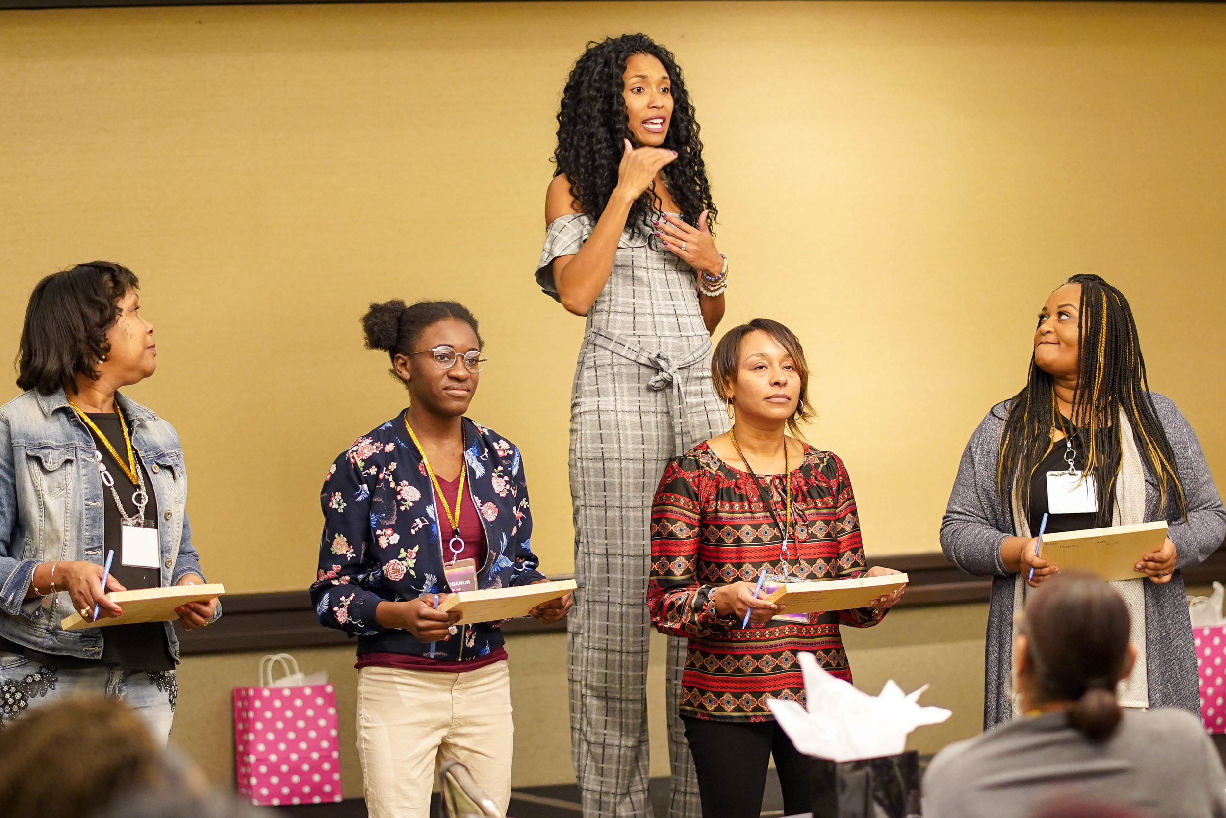 Lindsey Vertner helps women to literally breakthrough their fears at a women's empowerment conference.