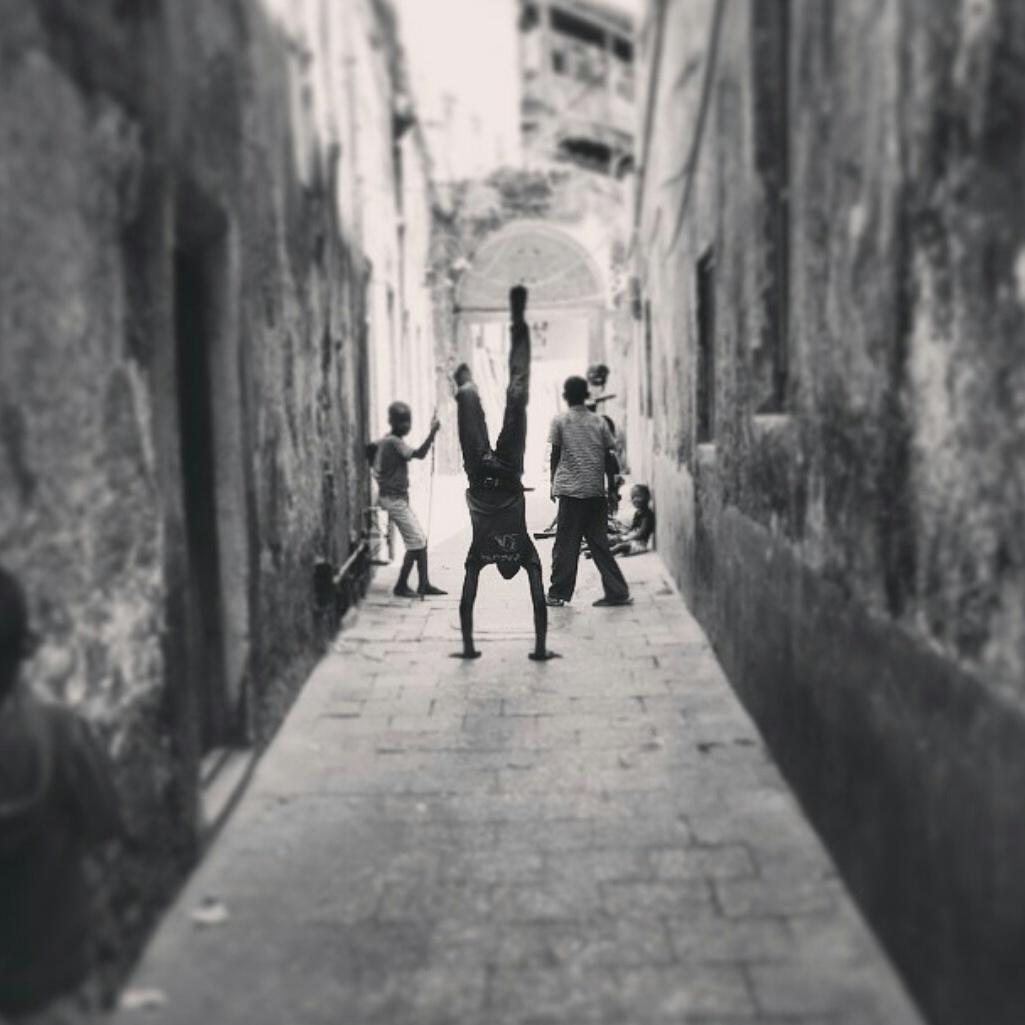 Zanzibar-kids-alley-acrobat-Stonetown.jpg