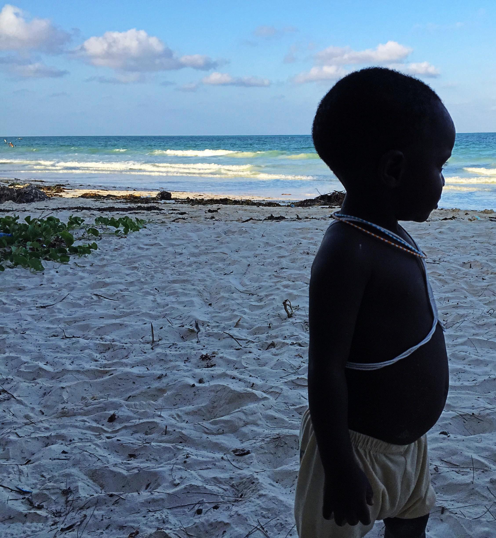 Zanzibar masai-baby-shadow-ocean.jpg