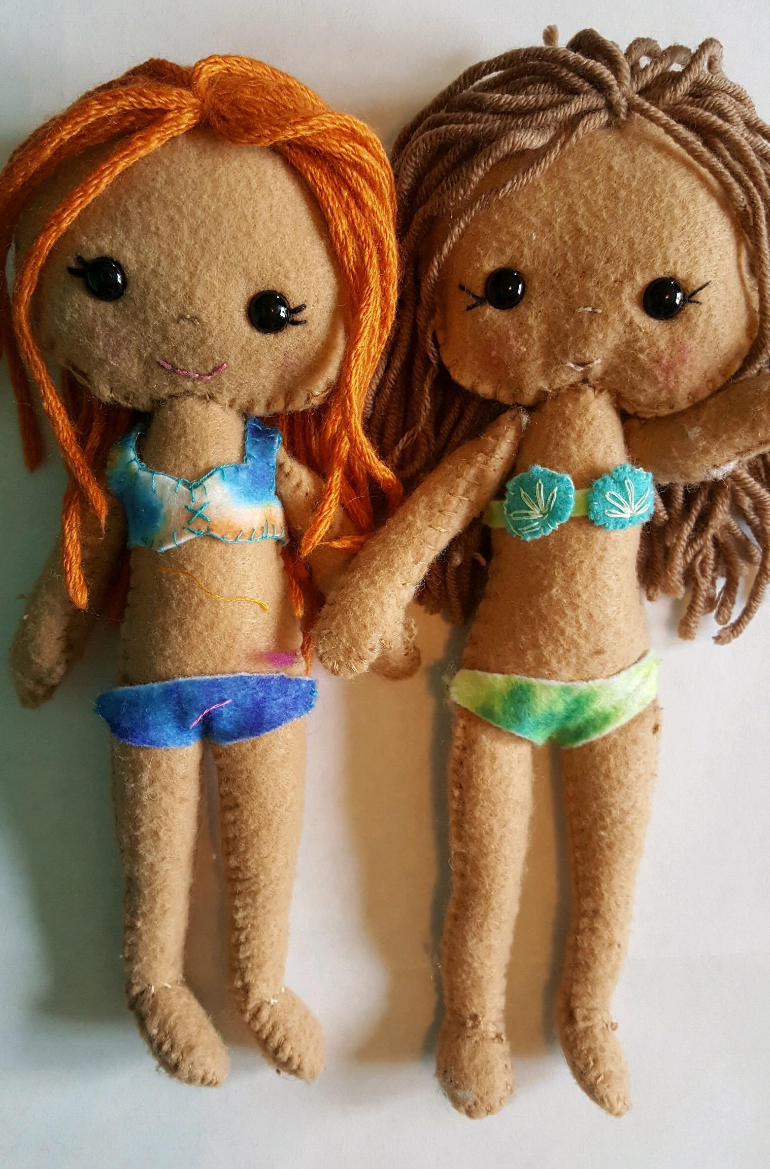 Redhead girl, handmade by Gabs             Brown haired girl, handmade by Calista