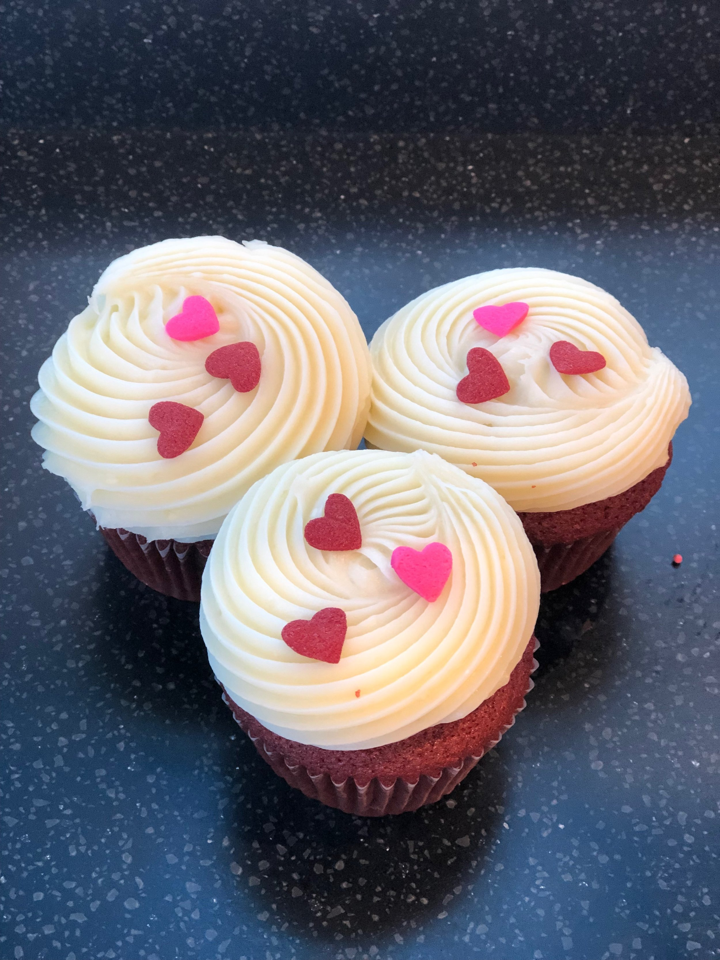 Red velvet cupcakes with hearts.JPG
