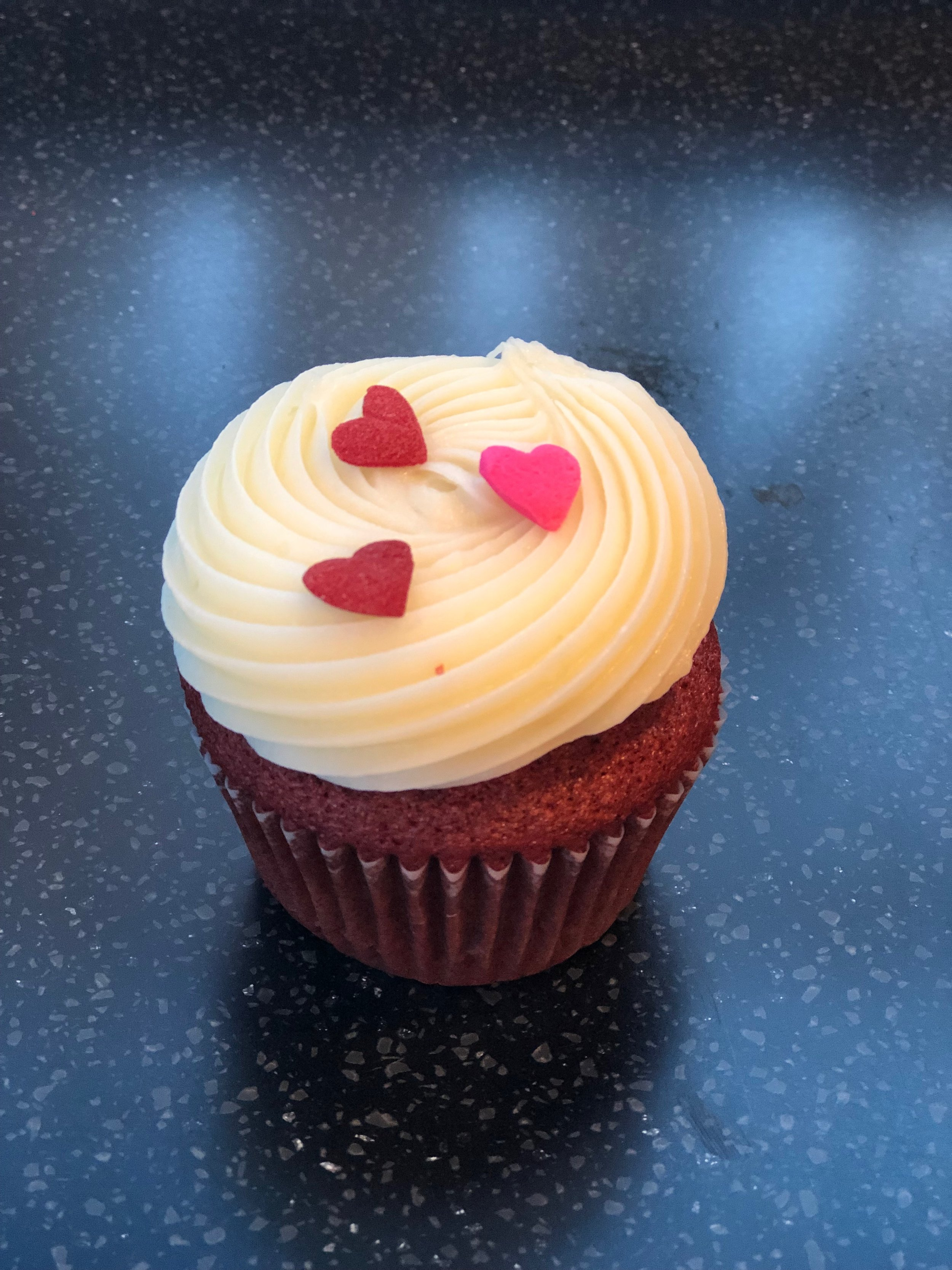 Red velvet cupcake with hearts.JPG