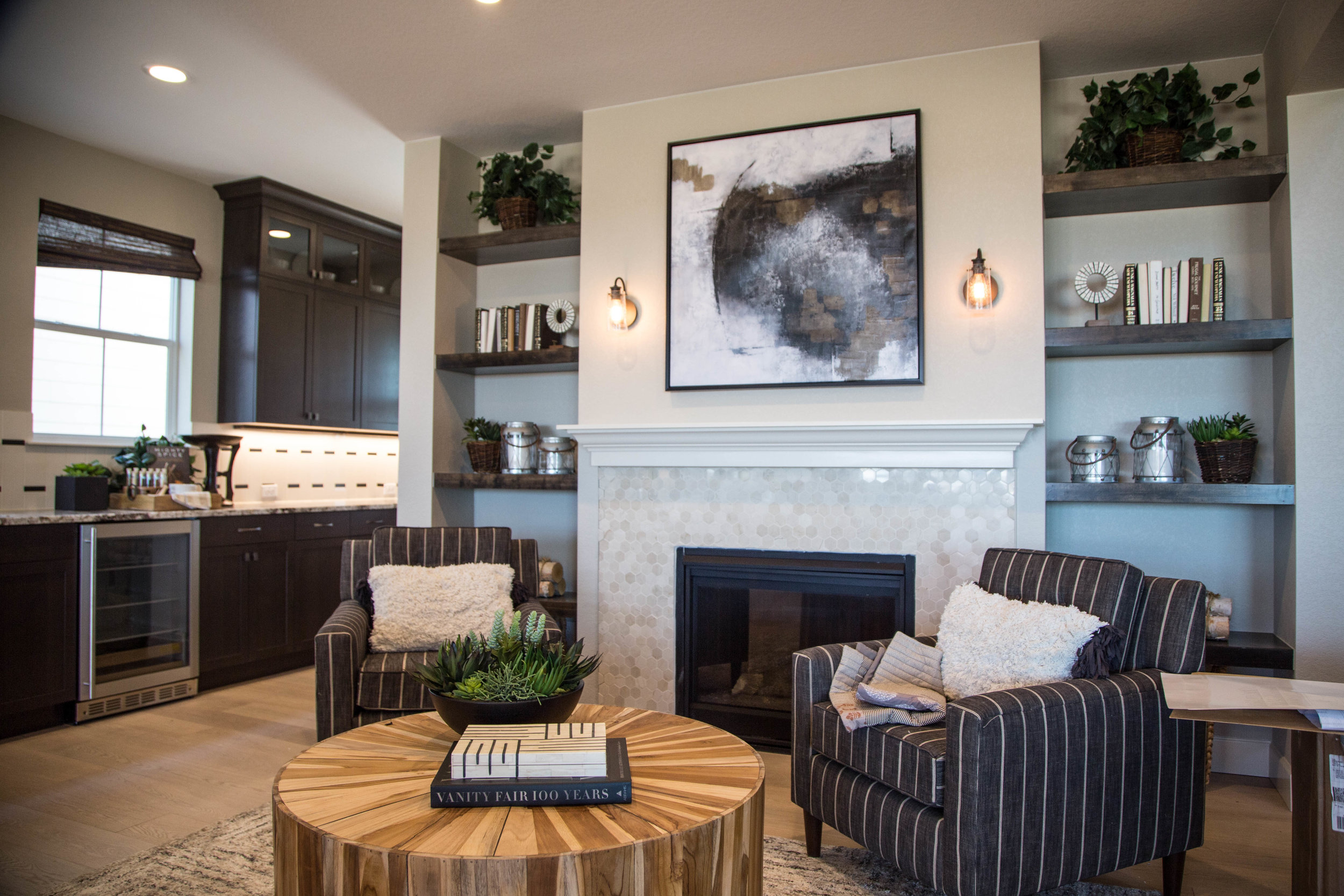 Elegant Wall Fixtures with Edison Bulbs frame this gas fireplace