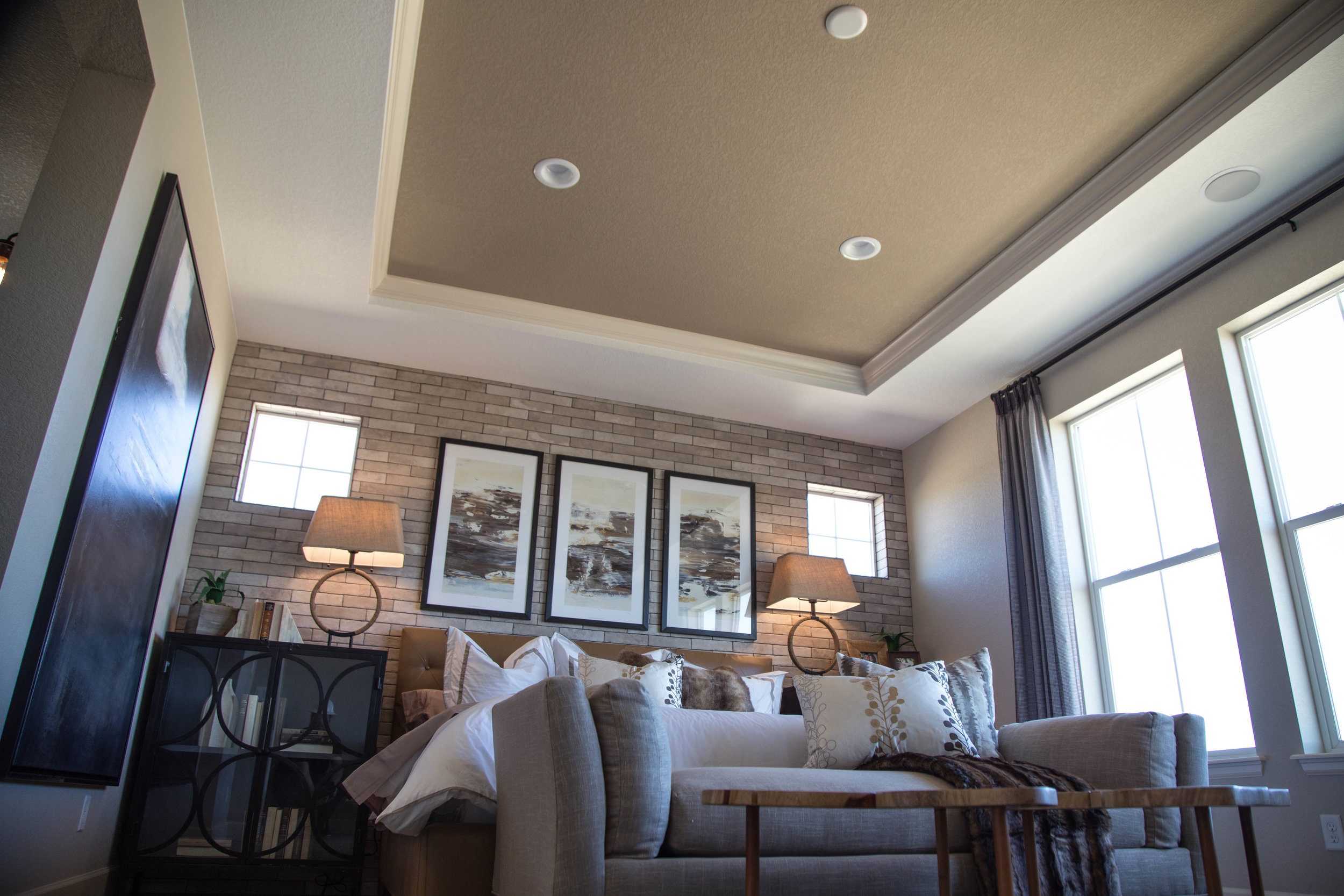 This room features both our Recessed LED Can Lighting as well as a pair of nearly invisible ceiling speakers from TruAudio.