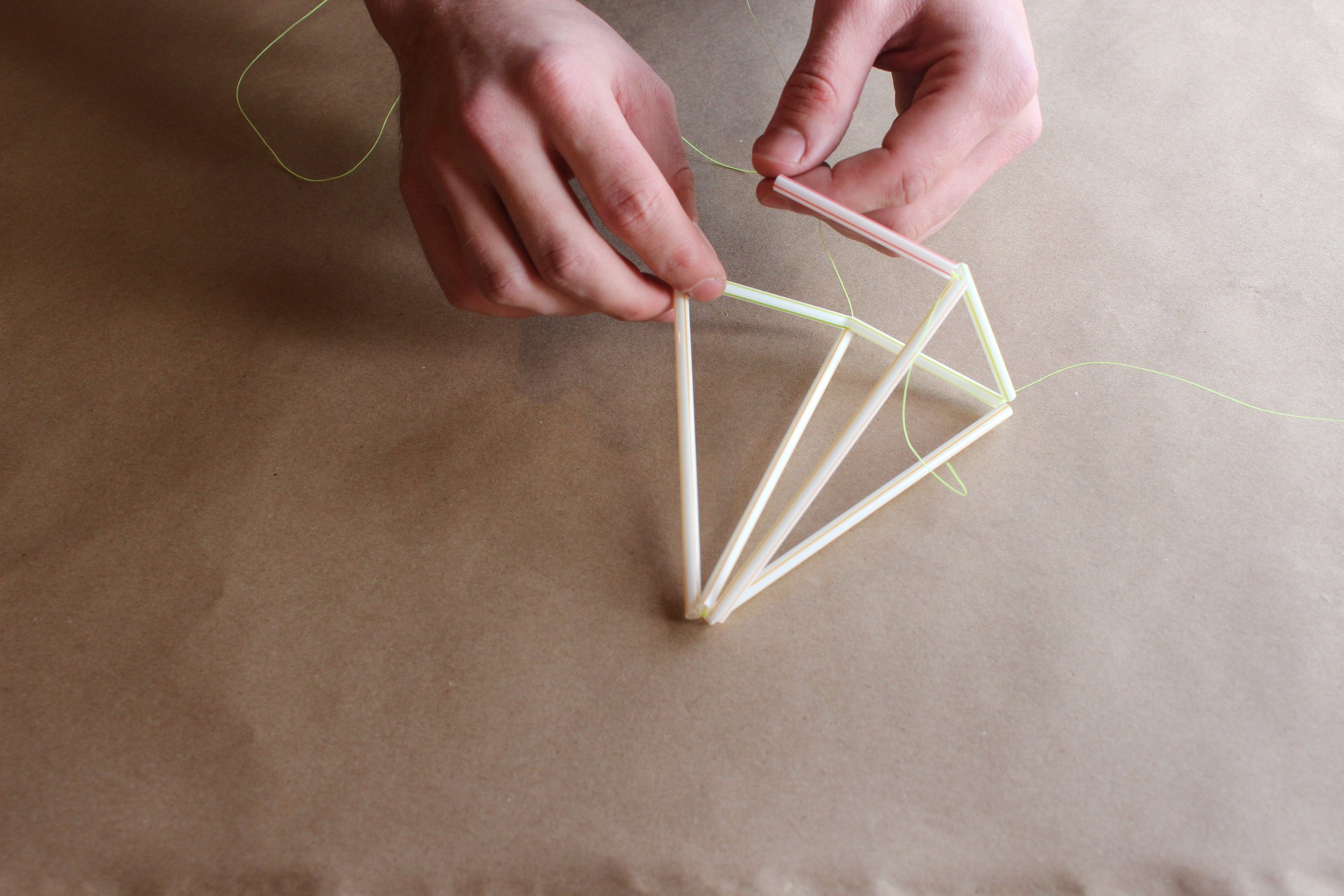 Step 7.) Attach the newest 2.5 inch straw on the left, to the bottom triangle piece on the right creating a square at the base.