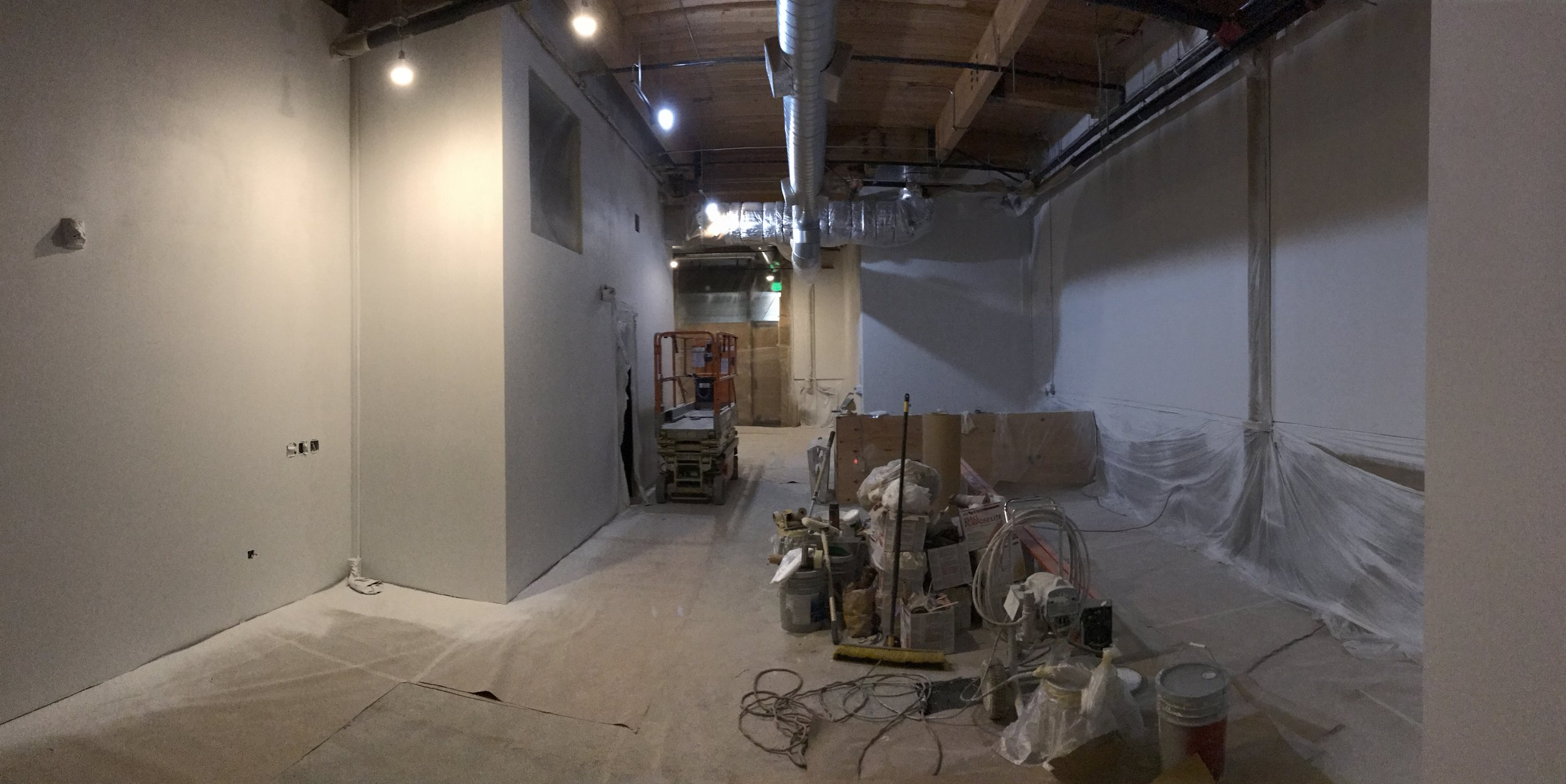 It's looking more like something! Lights,drywall, and HVAC! (notice the hole is covered)