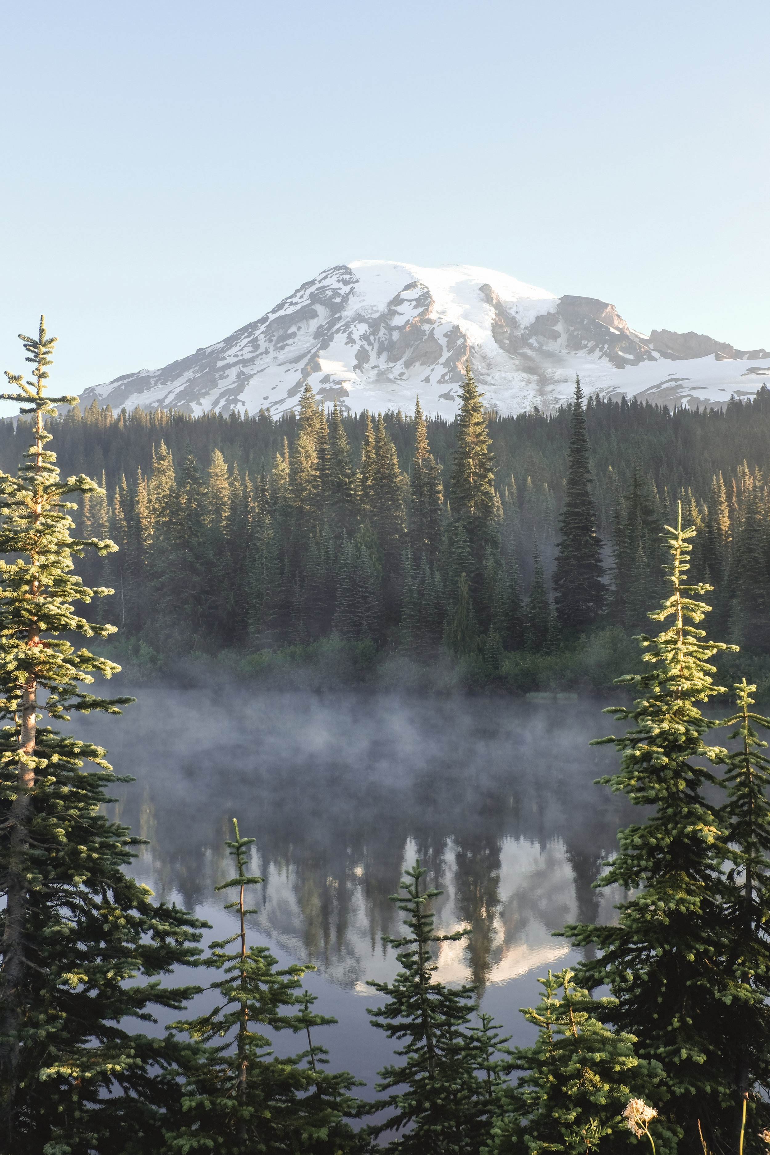 Early morning fog on the lake in Mt Rainier National Park, Washington