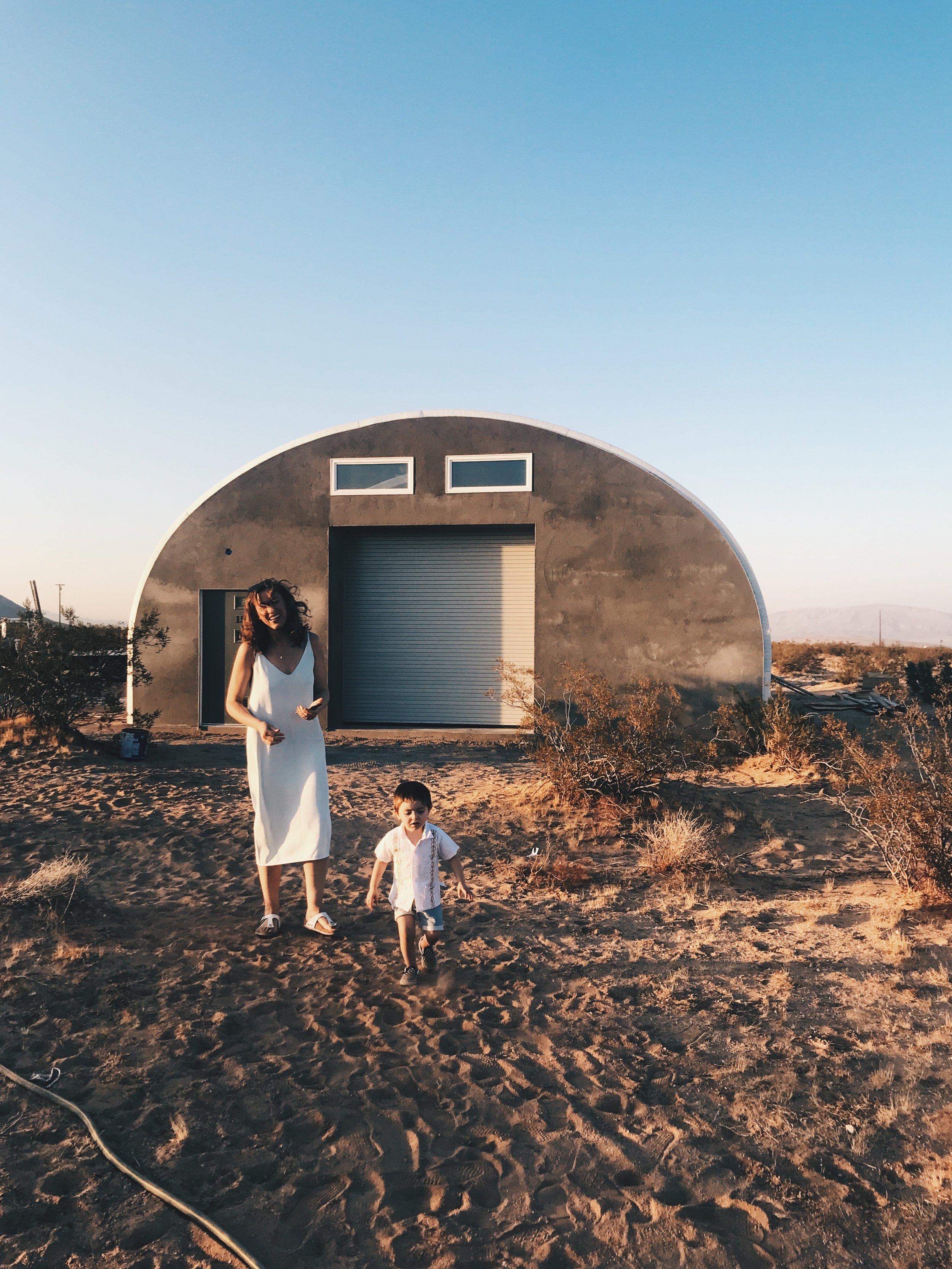 Emi & Momo exploring cousin Marie's new quanset hut she built in the middle of nowhere