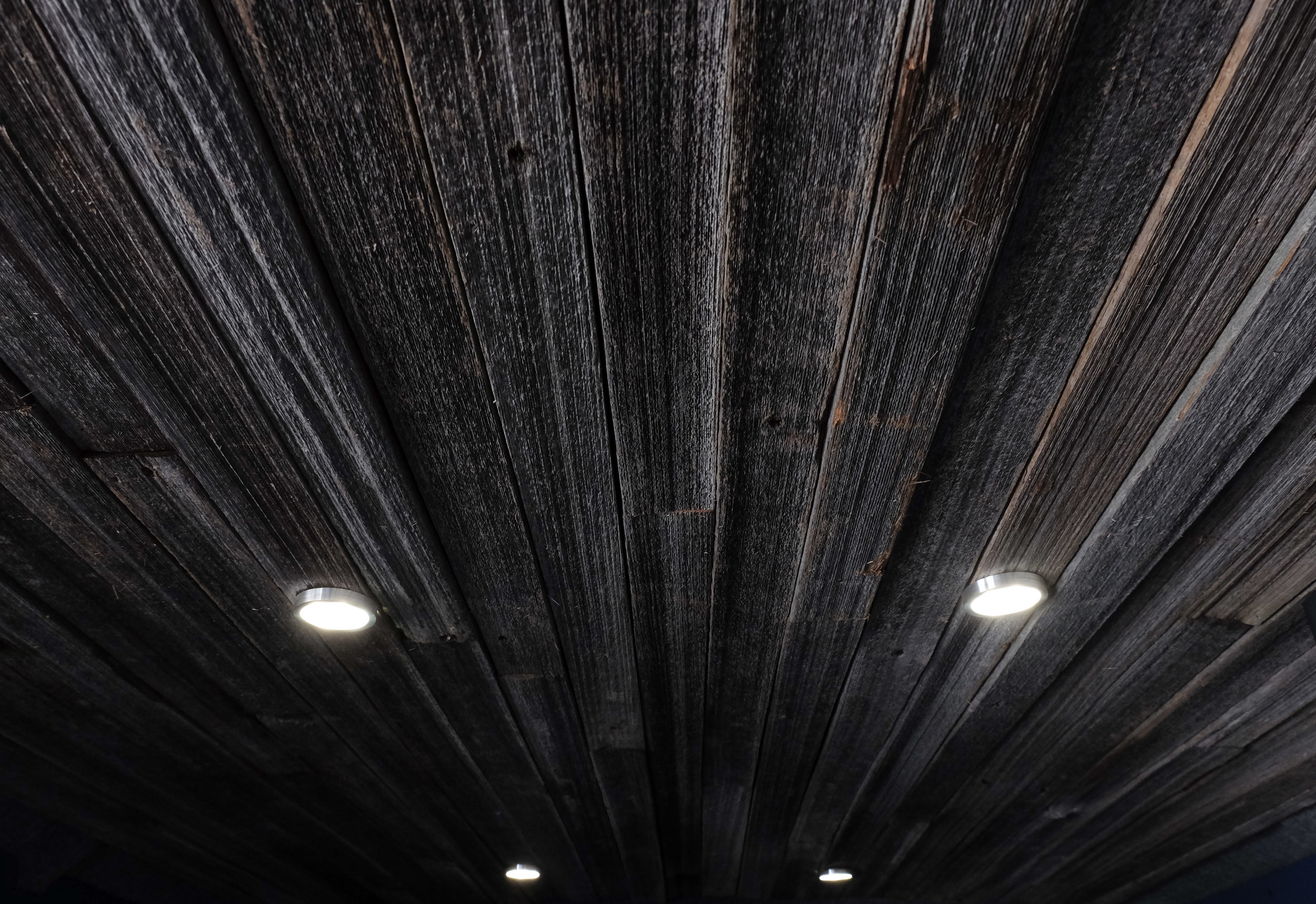 Custom wood ceilings have become a signature here at Vanlife Customs.  Here you can see a reclaimed wood ceiling with LED puck lighting installed.