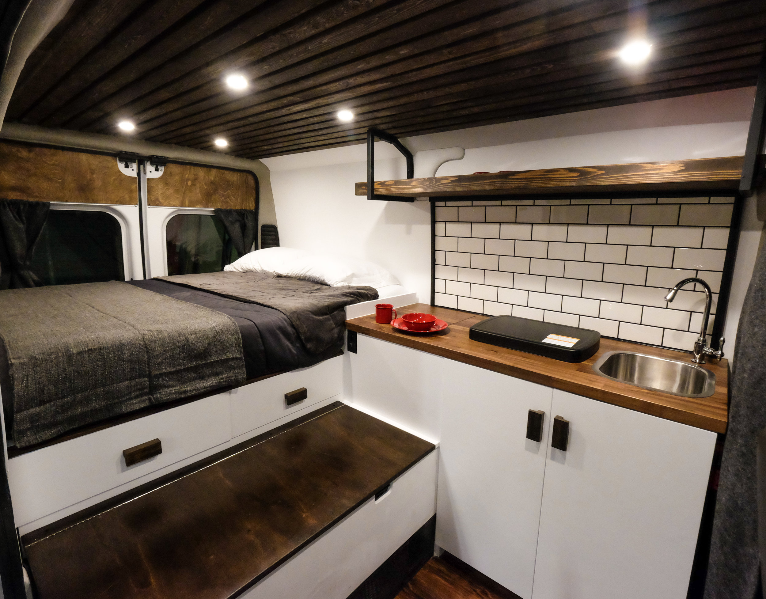 A tile backsplash and stainless steel sink add character to come home to after a long day on the road or on the trail. The bench and under-bed drawers complete the package with plenty of storage for all of your weekend gear.