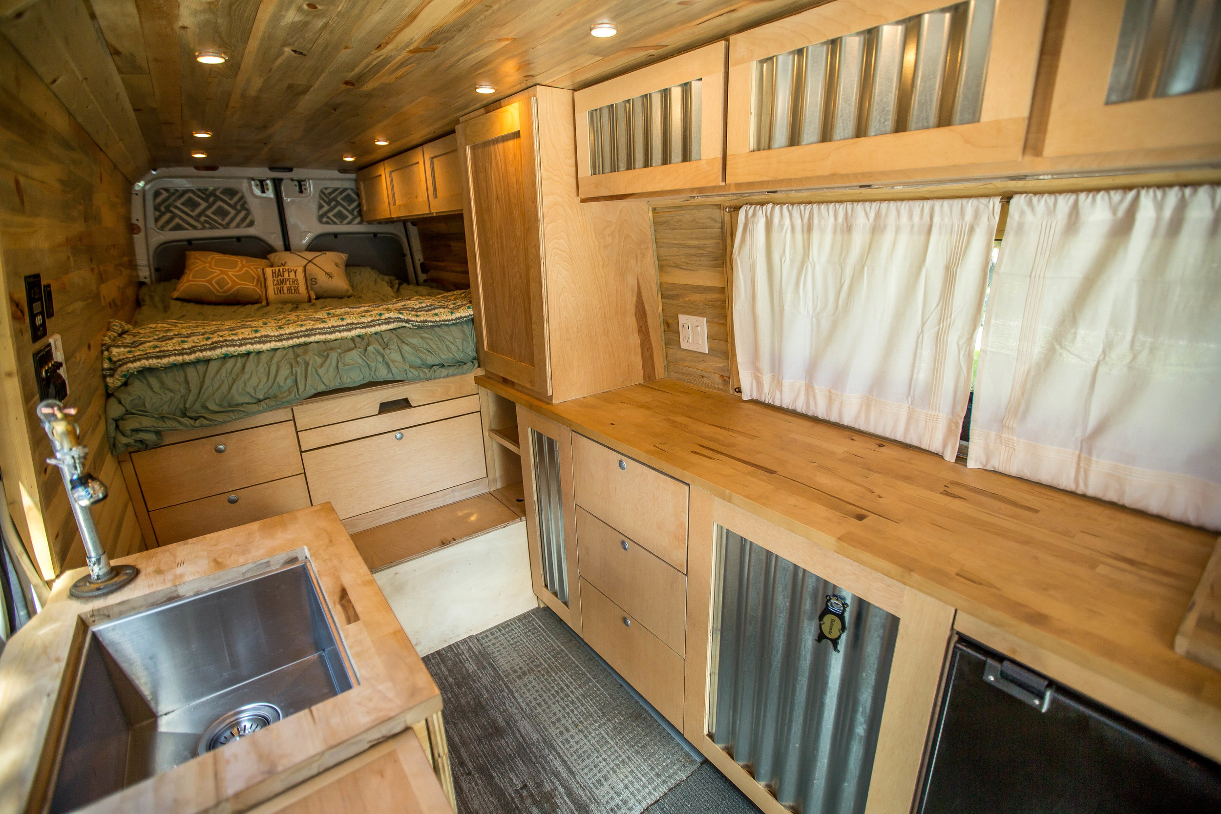 Amenities include beetle kill lined walls, fresh/grey water storage with electric pump, 3.0 cu.ft. refrigerator, LED lighting, and more.