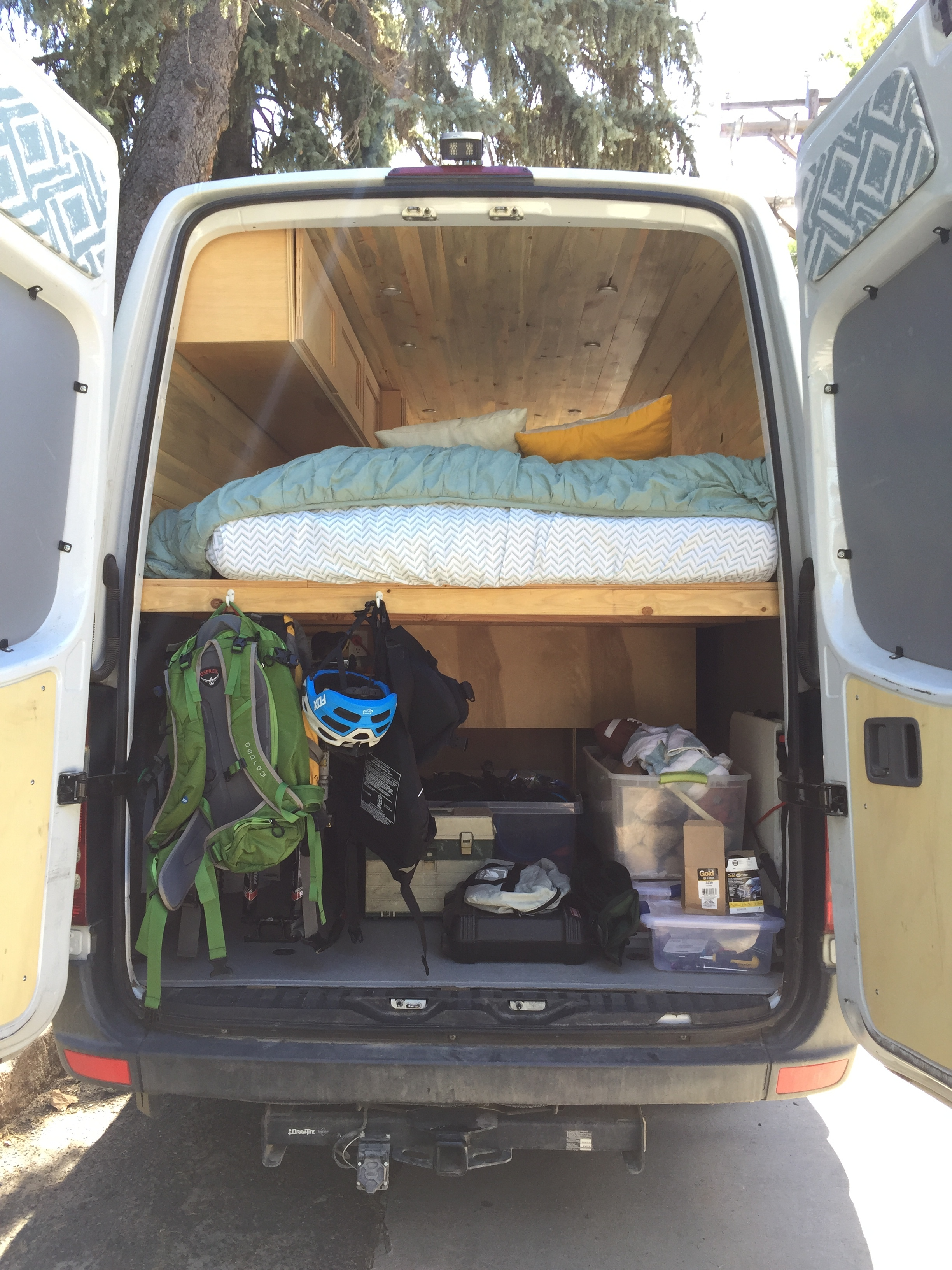 Underneath the large bed you'll find a full AM solar control center, battery storage, and a plethora of space for all of your adventure gear.