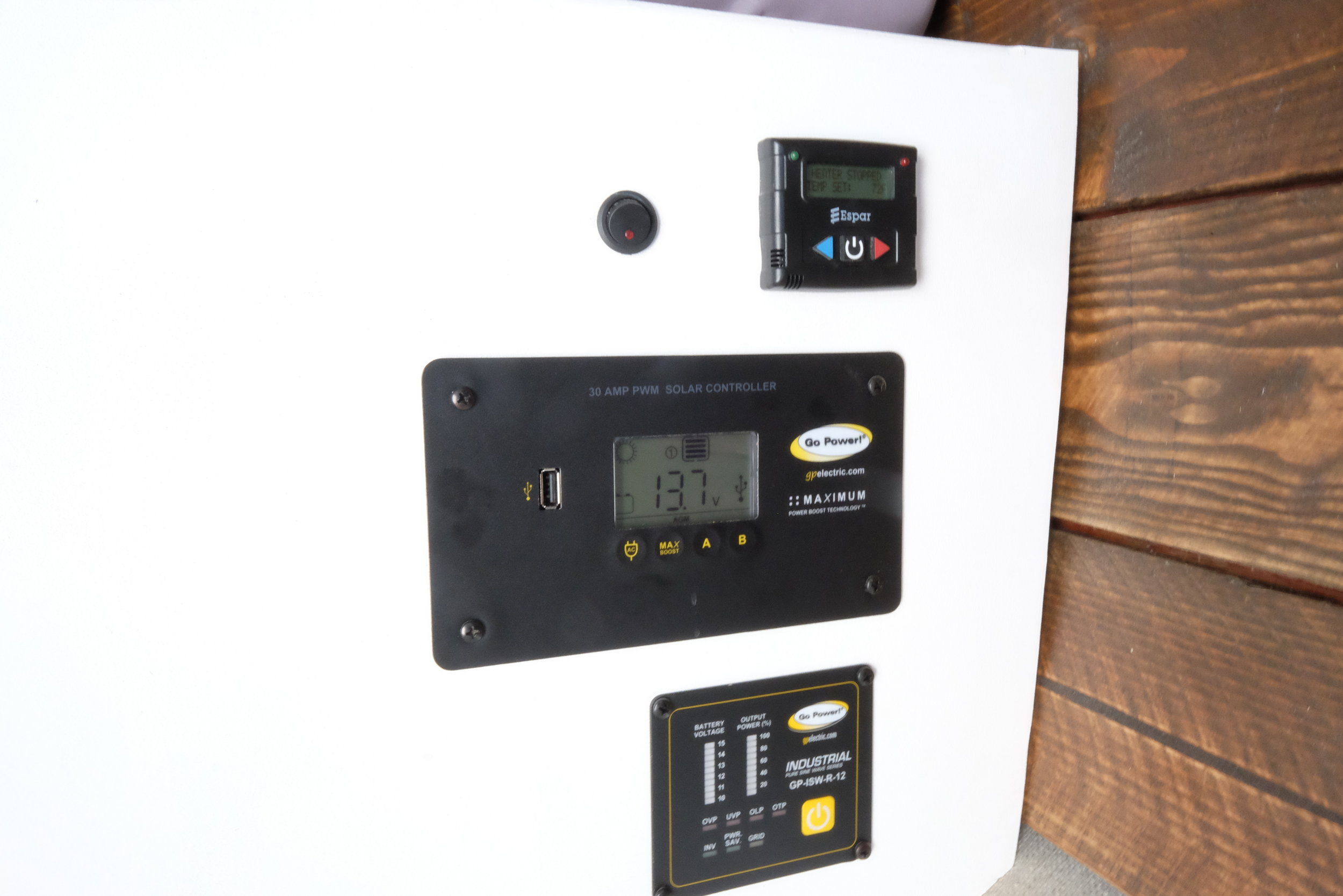 """A Go-Power solar set up, inverter, and controller take care of the electrical needs. Meanwhile, the fuel efficient Espar diesel fired heater runs warmly and quietly under the control of an easy to use """"set it and forget it"""" thermostat."""