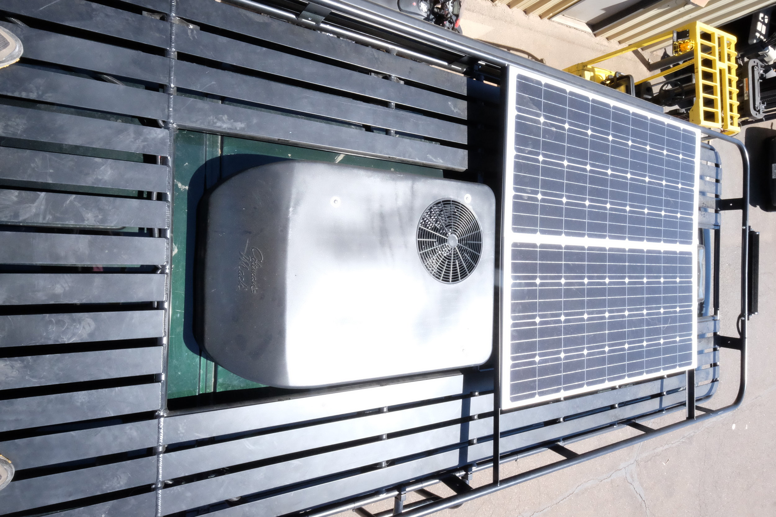 The Aluminess roof rack was designed to account for two large solar panels, the Coleman Mach 8, as well as a Maxxair vent fan. Although Aluminess products come with a heavy lead time, they are extremely tough looking and very functional.