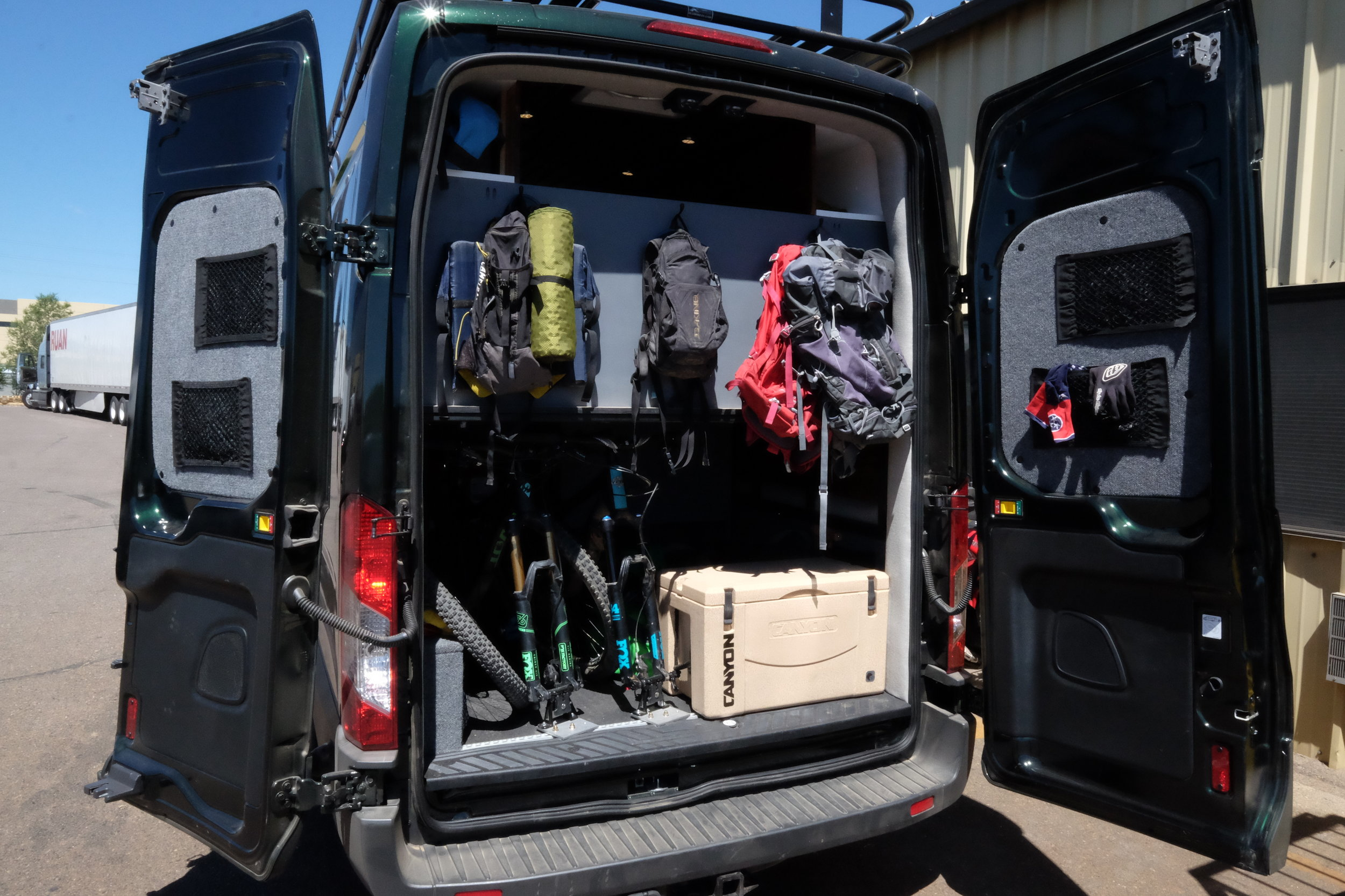 Not only does Dan's Transit look great, it functions well too. Here you can see the L-track mounted Rocky Mount bike mounts under the bed, not to mention room for coolers, outdoor gear, skis, and so much more.