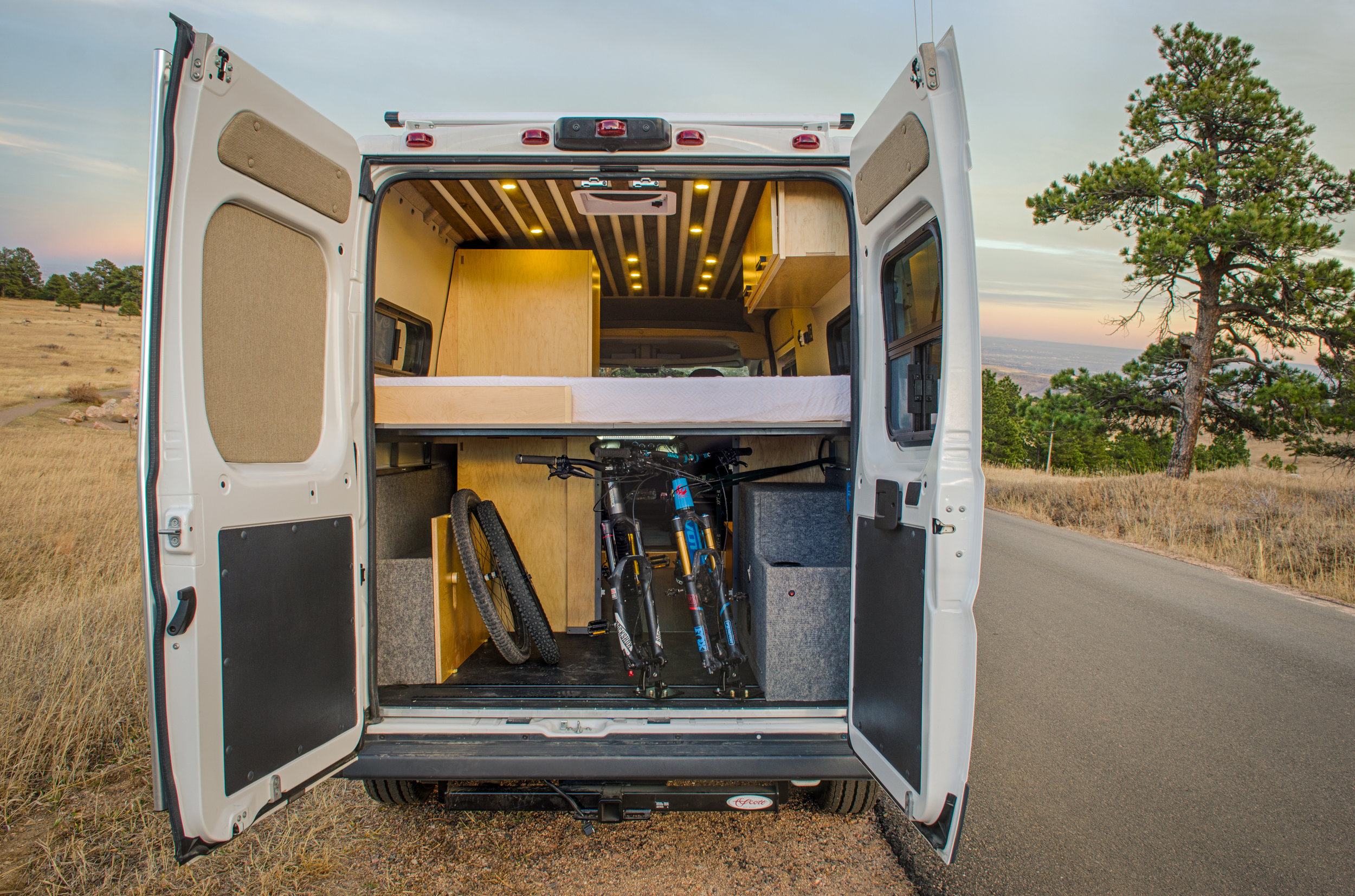 """Open up the back of this adventure van and you'll find 300AH of Battleborn lithium battery power storage, bluetooth enabled Smartsolar controller, a 2000W Go-Power inverter, shore power option, and room for two full size mountain bikes via l-track mounted """"Rocky Mounts""""."""