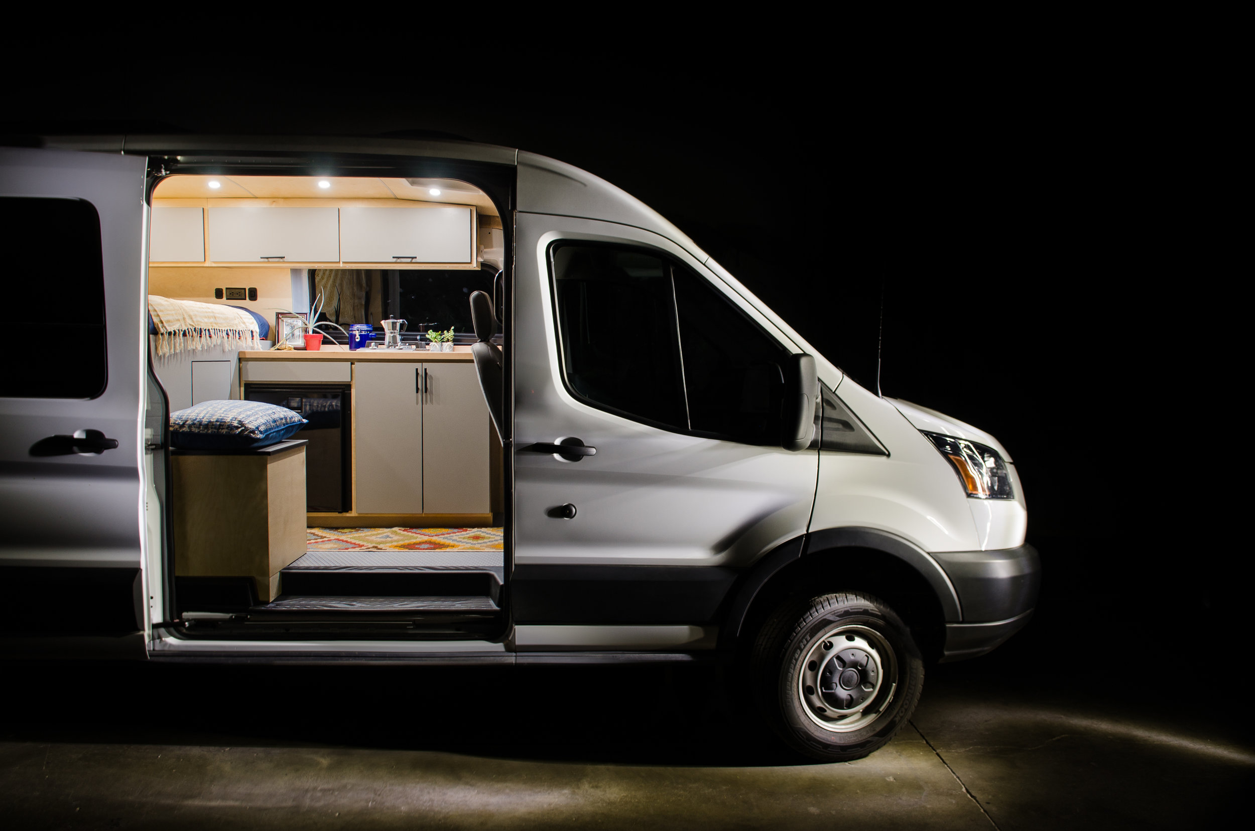 """This 148"""" Ford Transit (Medium Roof) was designed to be the ultimate home base during long mountain biking adventures."""