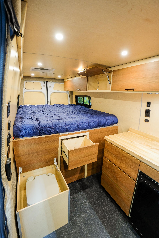 "Vanlife Customs 170"" Sprinter 4x4 Camper Van Conversion Storage and Toilet"