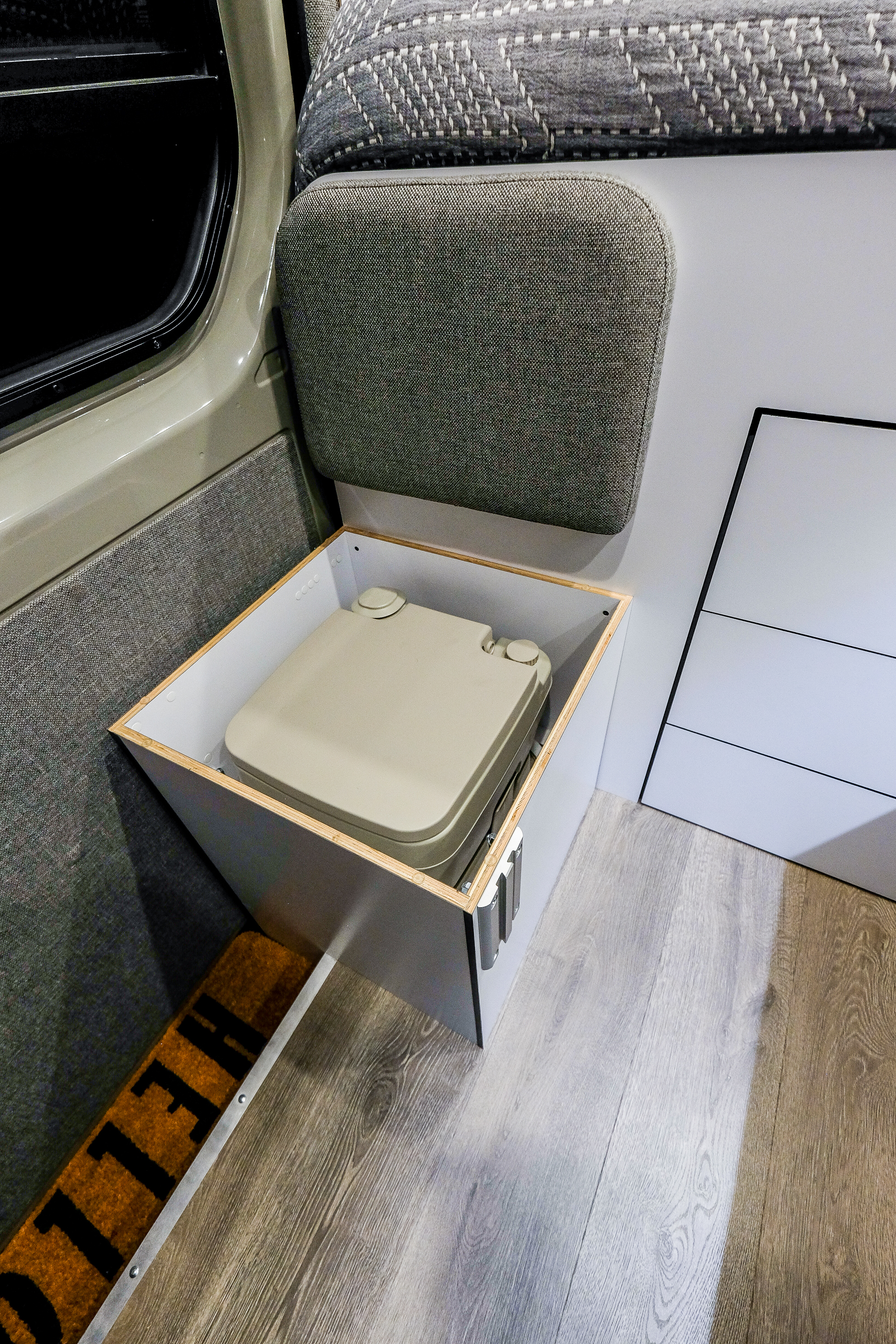 The jump seat has a hidden cassette toilet tucked neatly inside.