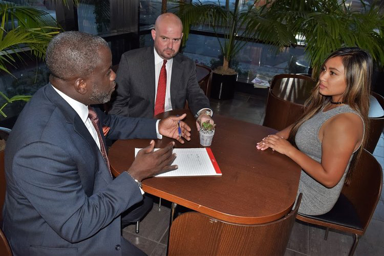San Diego Criminal Defense Attorneys Ryan J. Tegenlia and Marcus E. DeBose conduct a meeting at EmailMyLawyer.com lobby 187.jpg