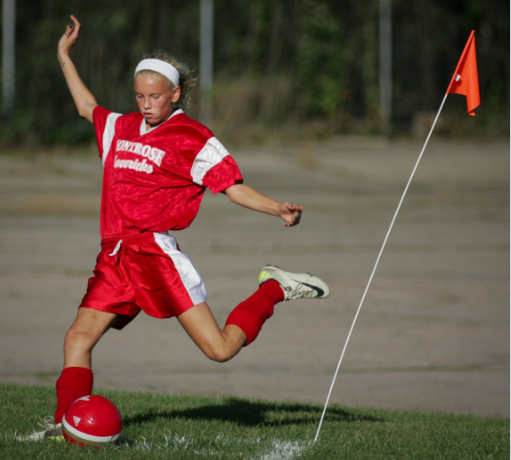 Taking a corner kick on the soccer field; Elizabeth was an avid athlete.