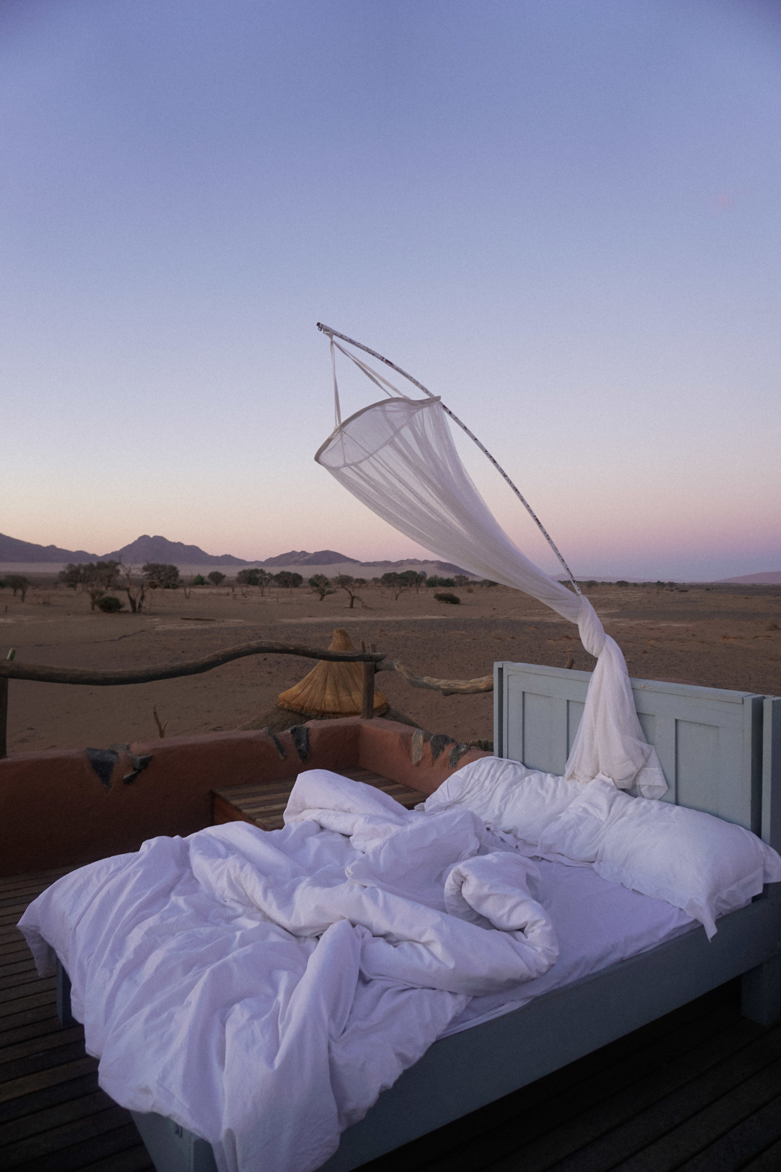 curio.trips.namibia.sossusvlei.lodge.bed.under.stars.jpg