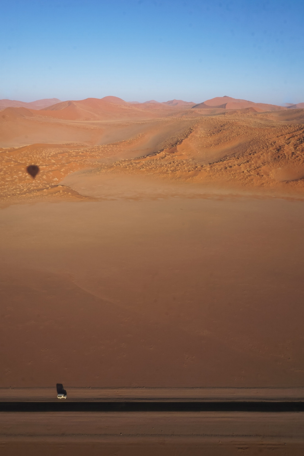 curio.trips.namibia.sossusvlei.hot.air.balloon.dunes.shadow.road.jpg