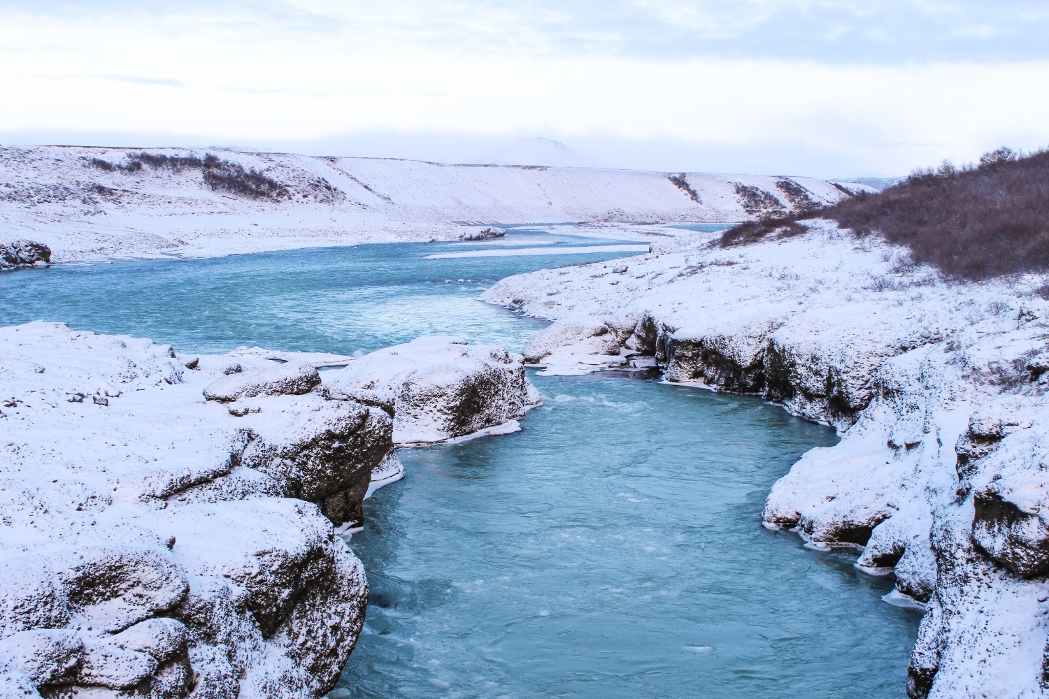curio.trips.iceland.winter.blue.river.jpg