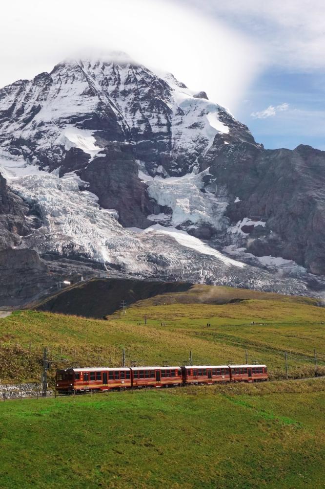 curio.trips.switzerland.mountain.red.train.portrait.jpg