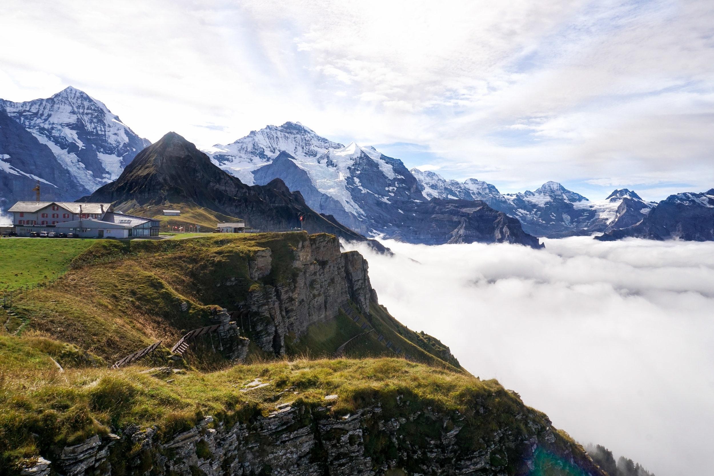 curio.trips.switzerland.jungfrau.peak.clouds.landscape-2.jpg