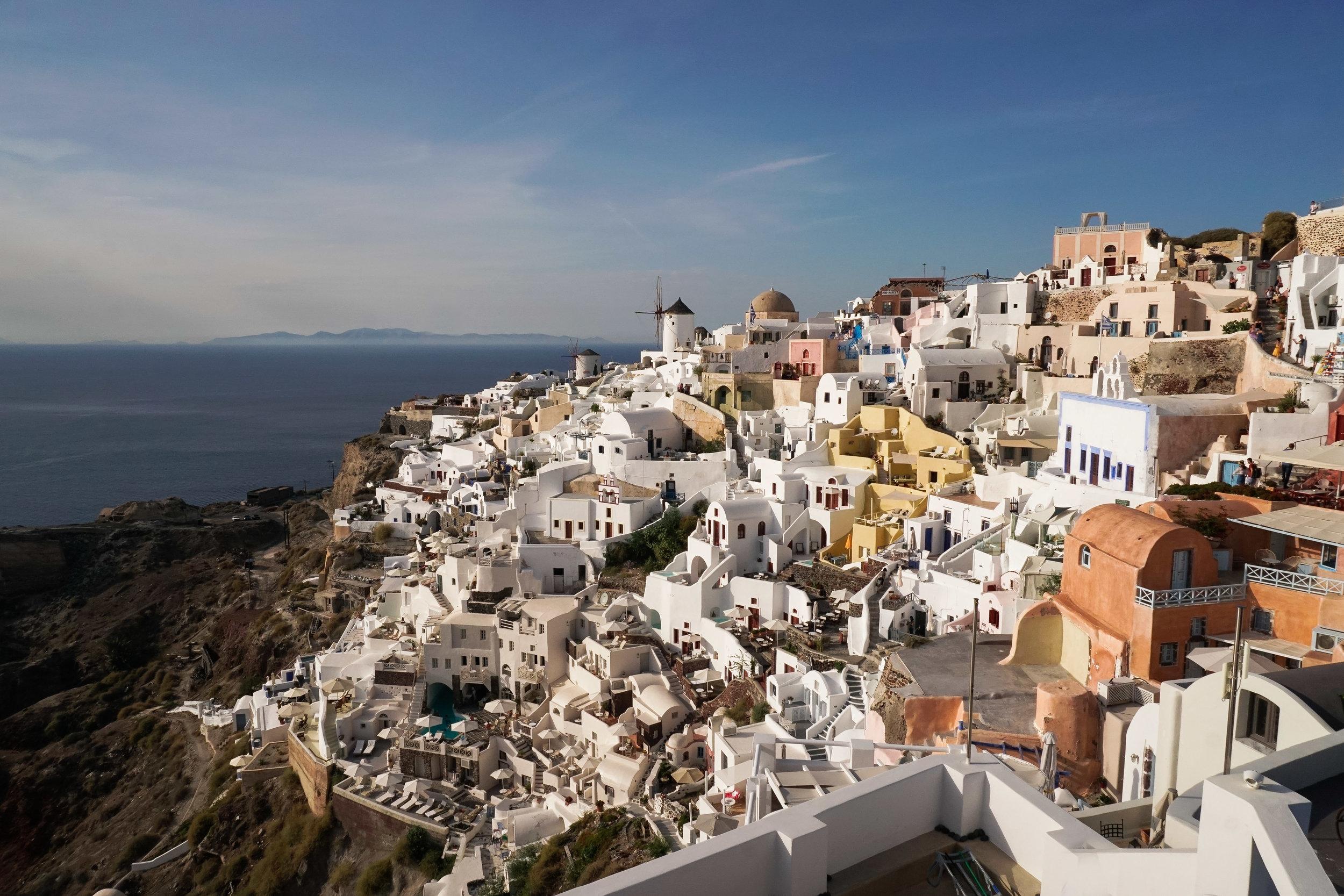 curio.trips.greece.santorini.windmill.view.day.landscape.jpg