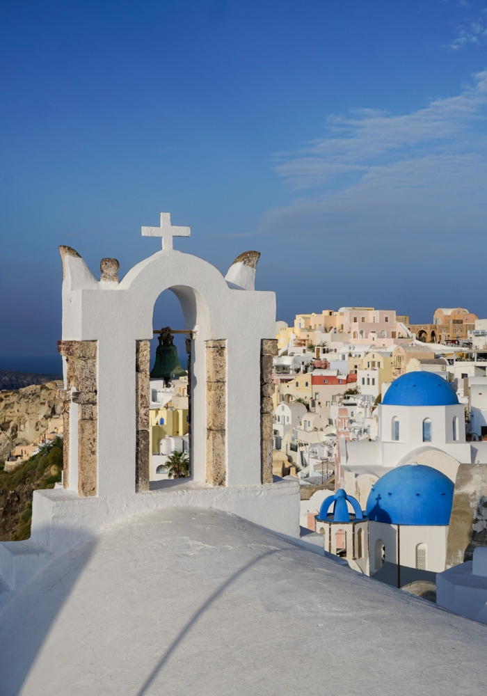 curio.trips.greece.santorini.architecture.white.black.churches.view.portrait.jpg
