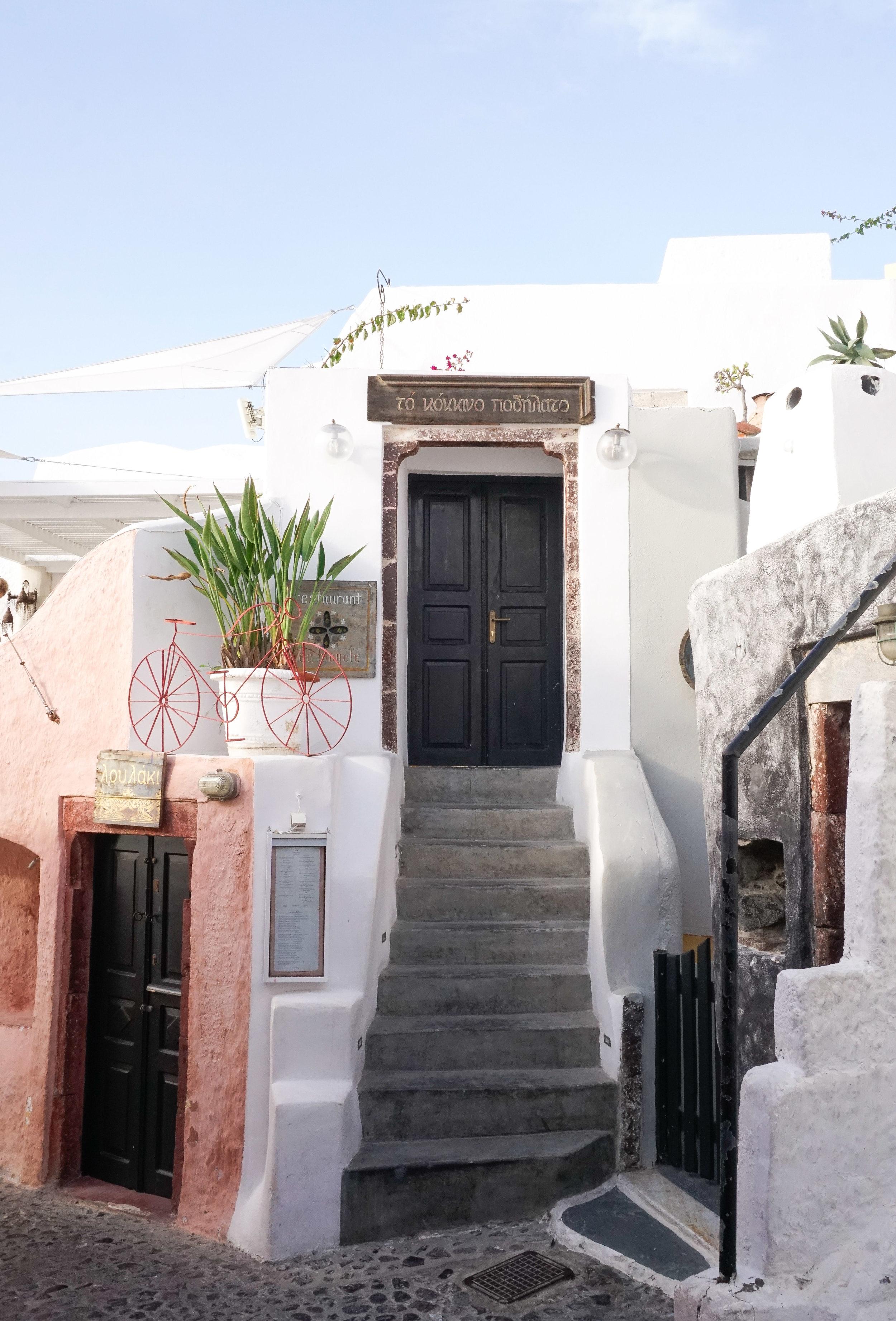 curio.trips.greece.santorini.street.scene.portrait.jpg