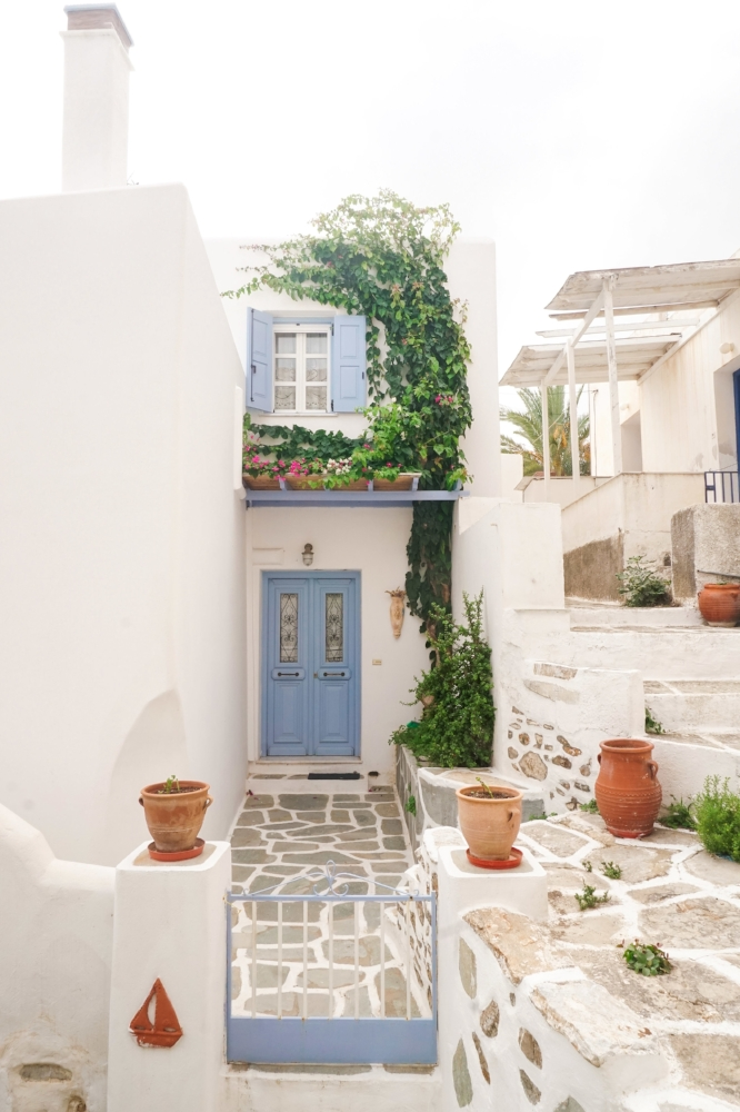 curio.trips.greece.paros.white.house.blue.door.portrait.jpg