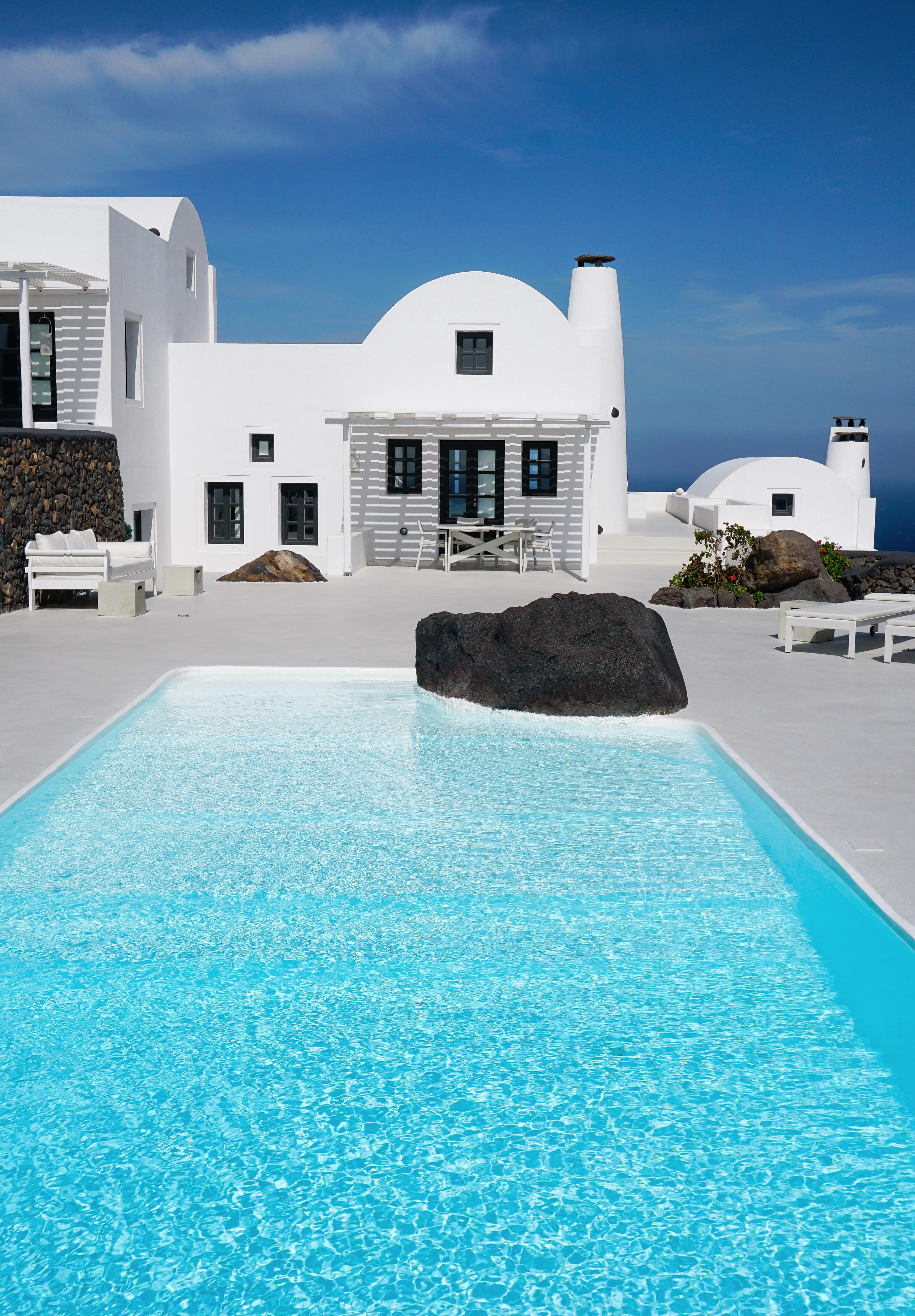 curio.trips.greece.santorini.villa.pool.portrait.jpg