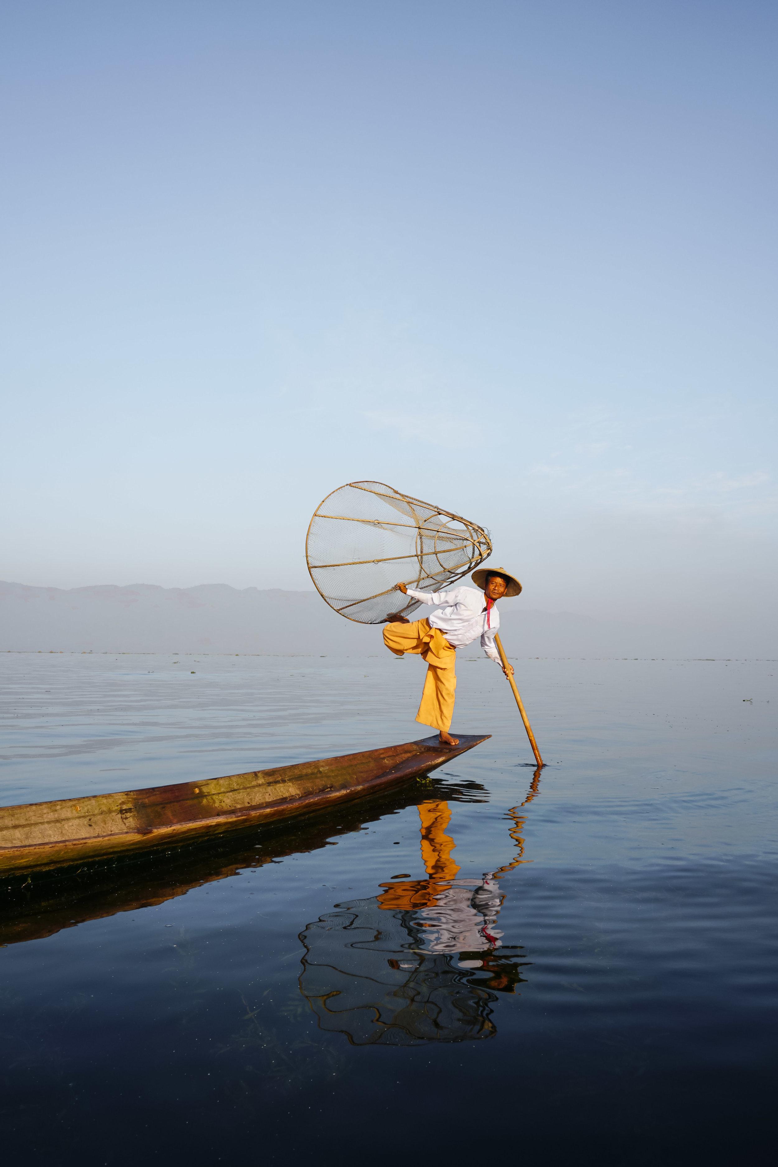 curio.trips.myanmar.inle.lake.fisherman.net.leg.portrait.jpg