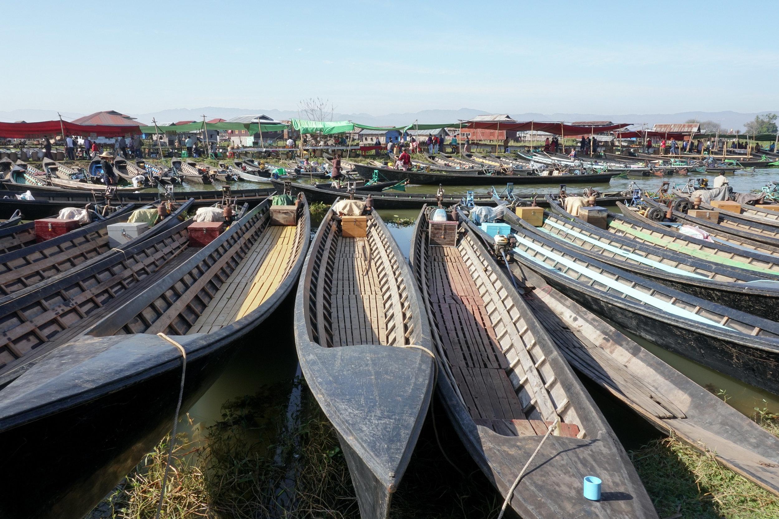 curio.trips.myanmar.inle.lake.market.boats.landscape.jpg