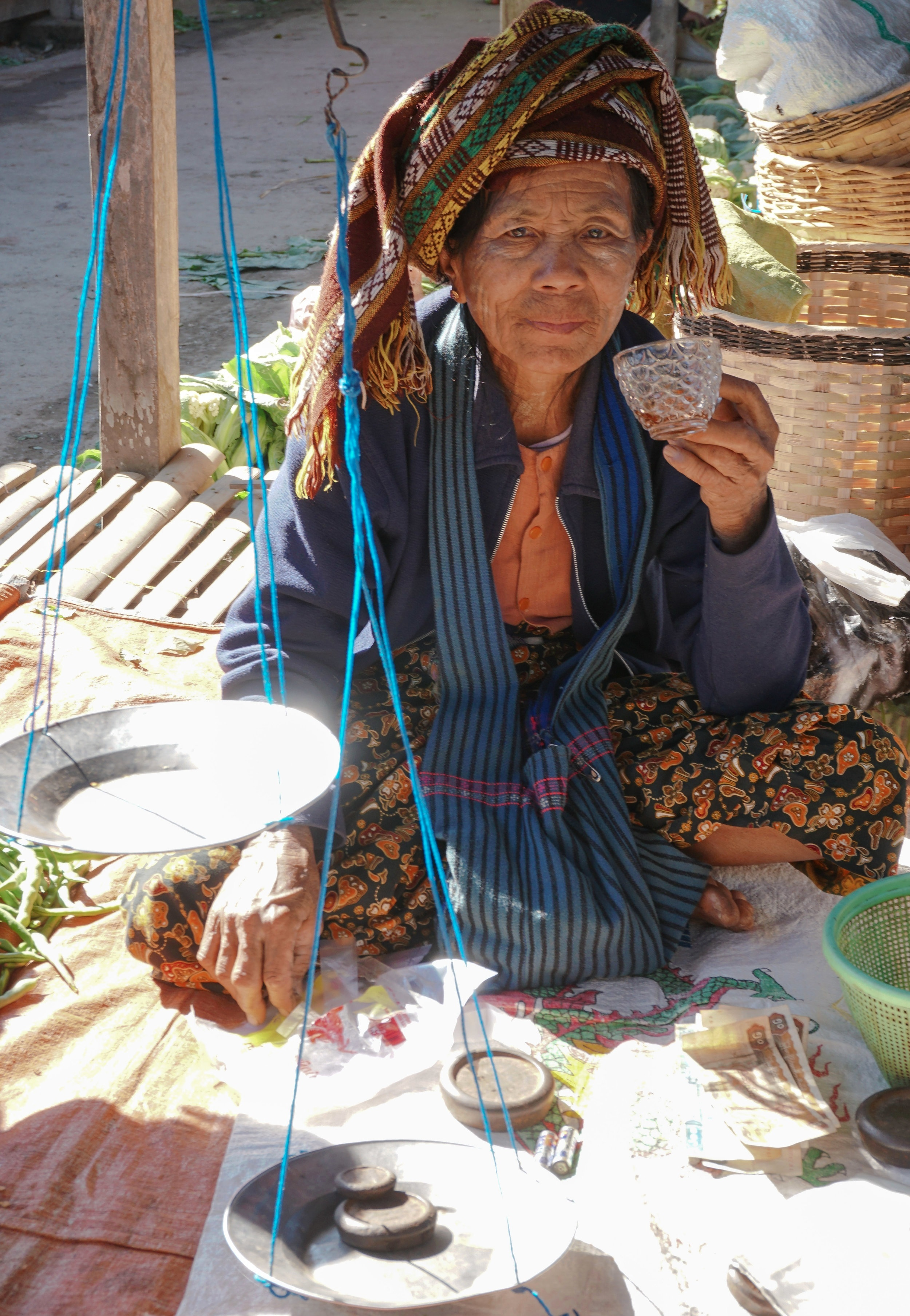 curio.trips.myanmar.inle.lake.market.woman.portrait.jpg