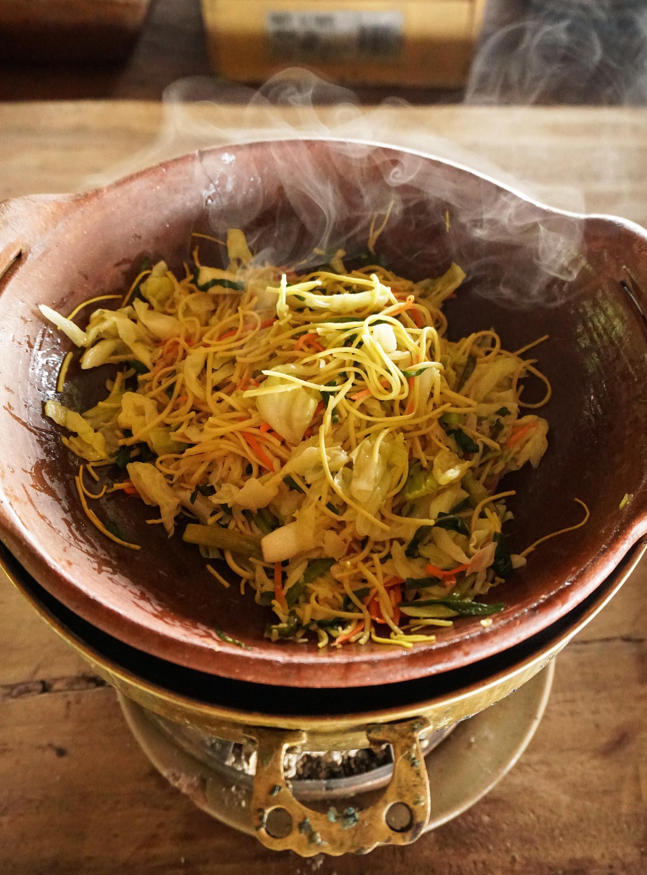 curio.trips.thailand.chiang.rai.steaming.noodles.portrait.jpg