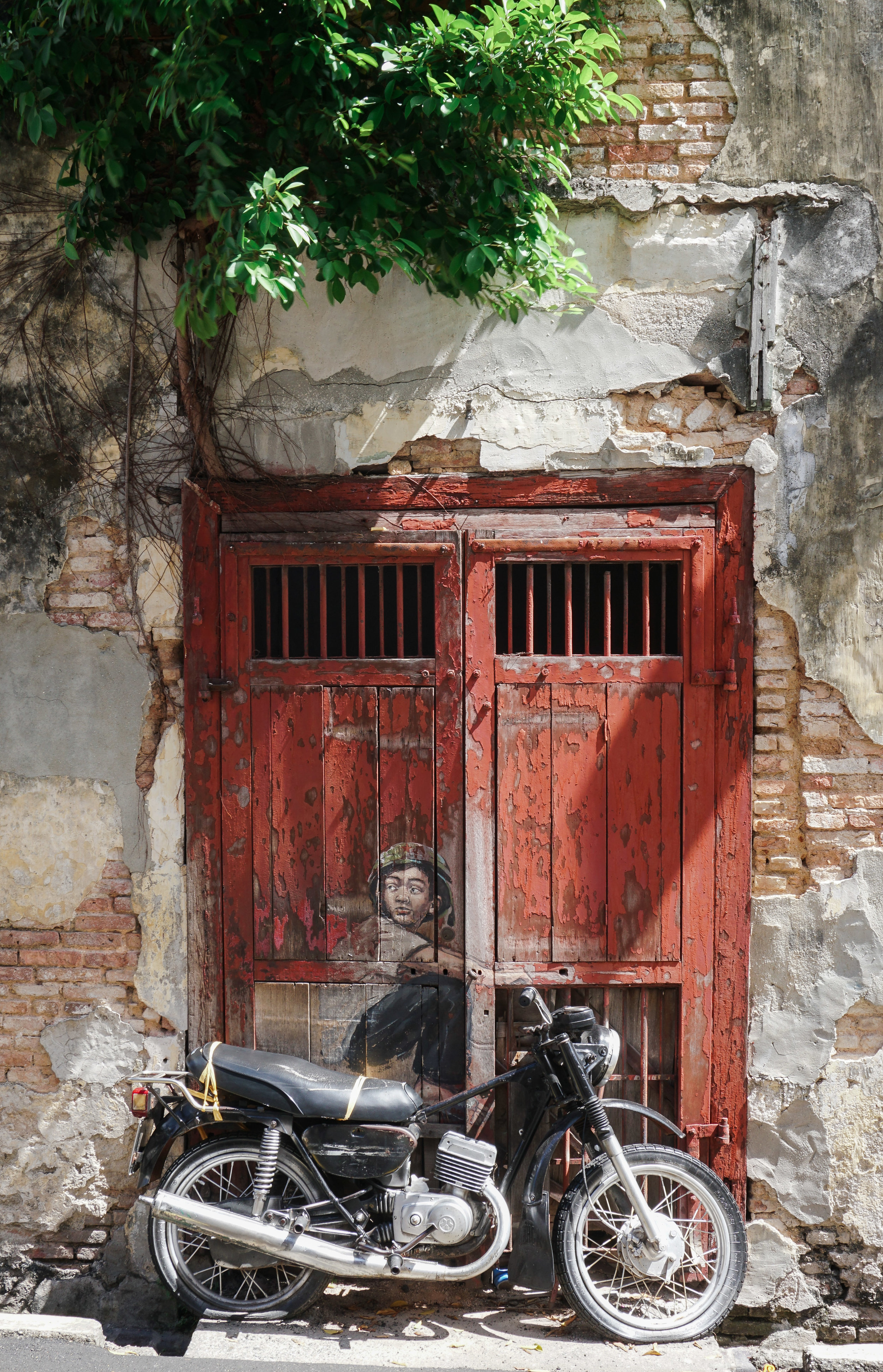 curio.trips.malaysia.penang.street.art.boy.on.bike.portrait.jpg