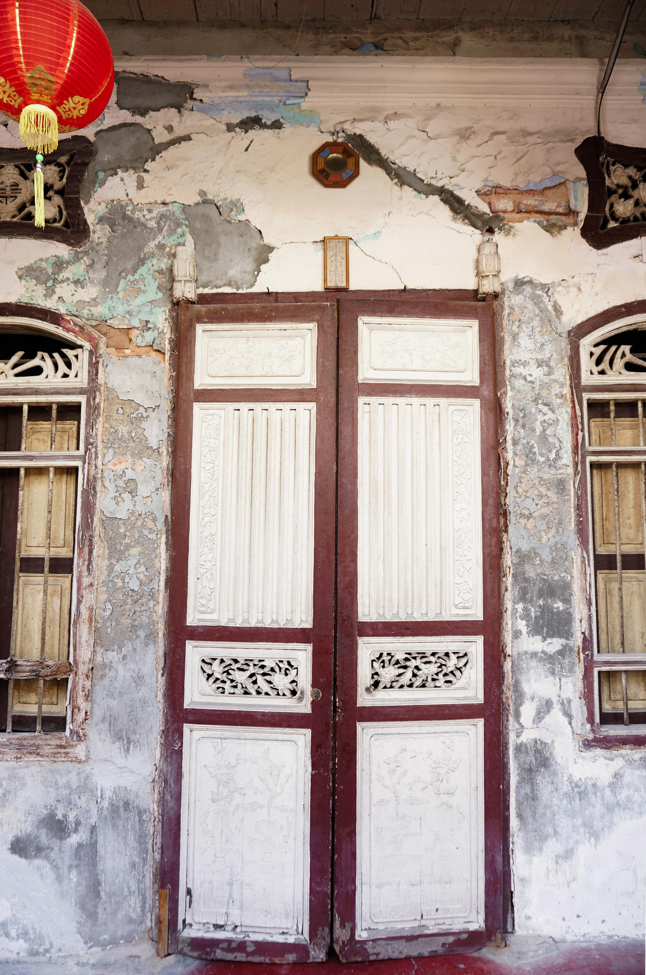 curio.trips.malaysia.penang.white.door.red.lantern.portrait.jpg